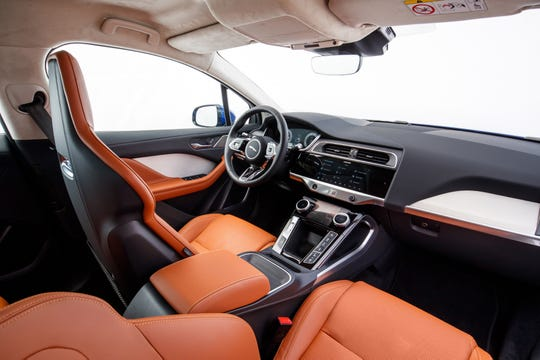 The interior of our test I-PACE, which stickered at nearly $89,000, featured premium Windsor Leather and a suede-like headliner material, along with an upmarket sound system.