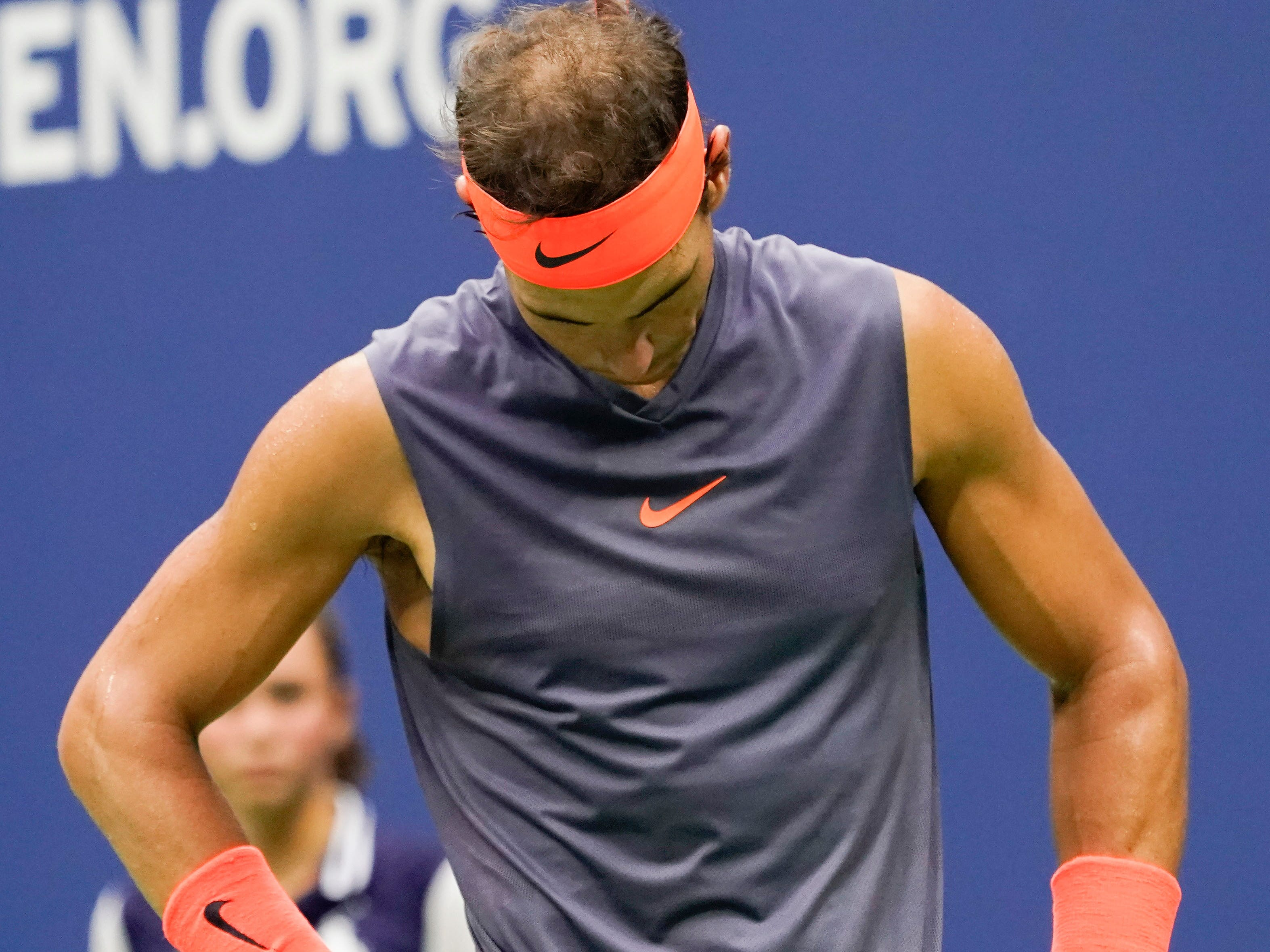 Rafael Nadal reacts to a missed shot against  Juan Martin del Potro.