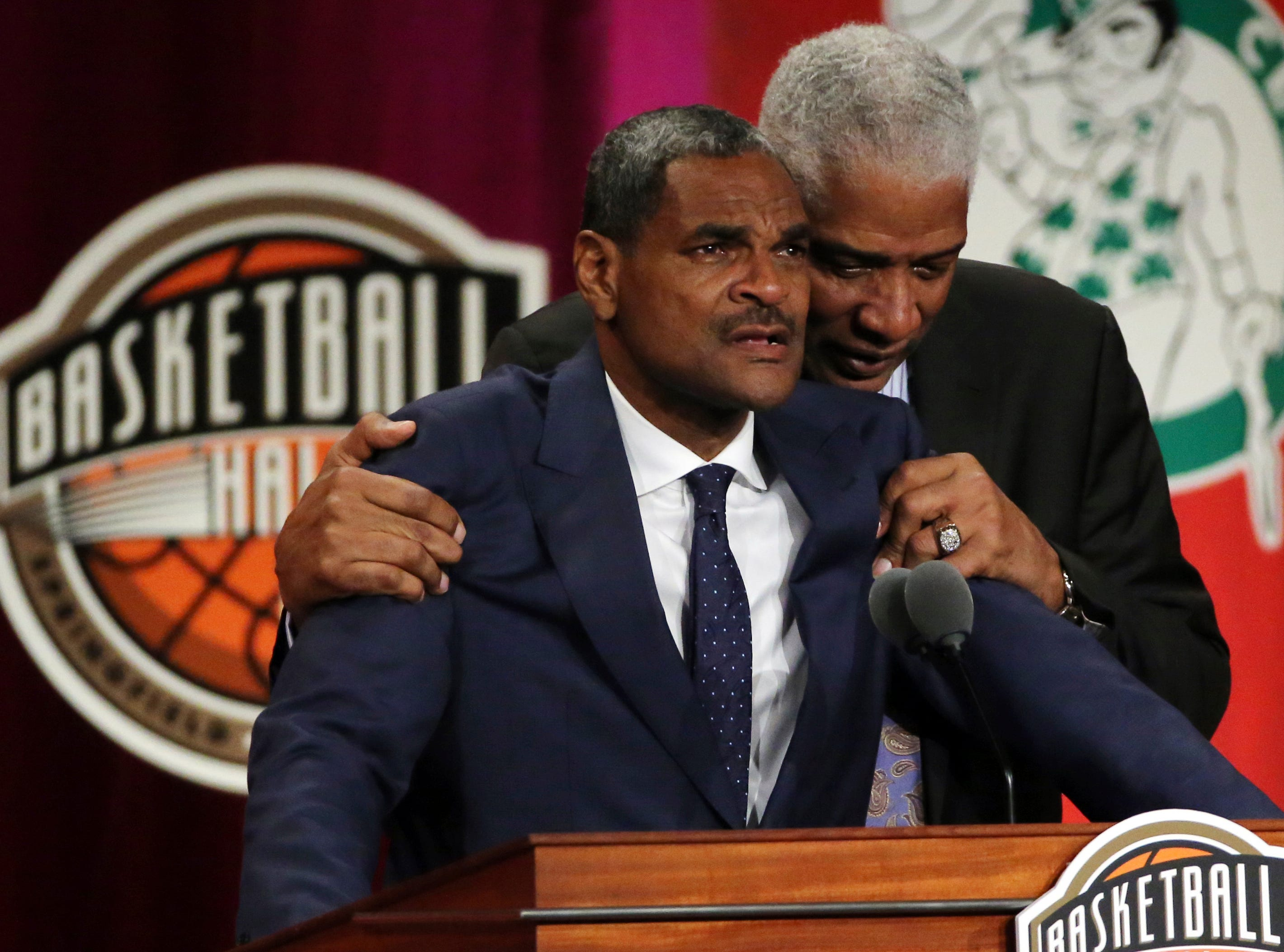 Maurice Cheeks, left, is hugged by Hall of Famer Julius Erving while speaking during induction ceremonies for the Basketball Hall of Fame.
