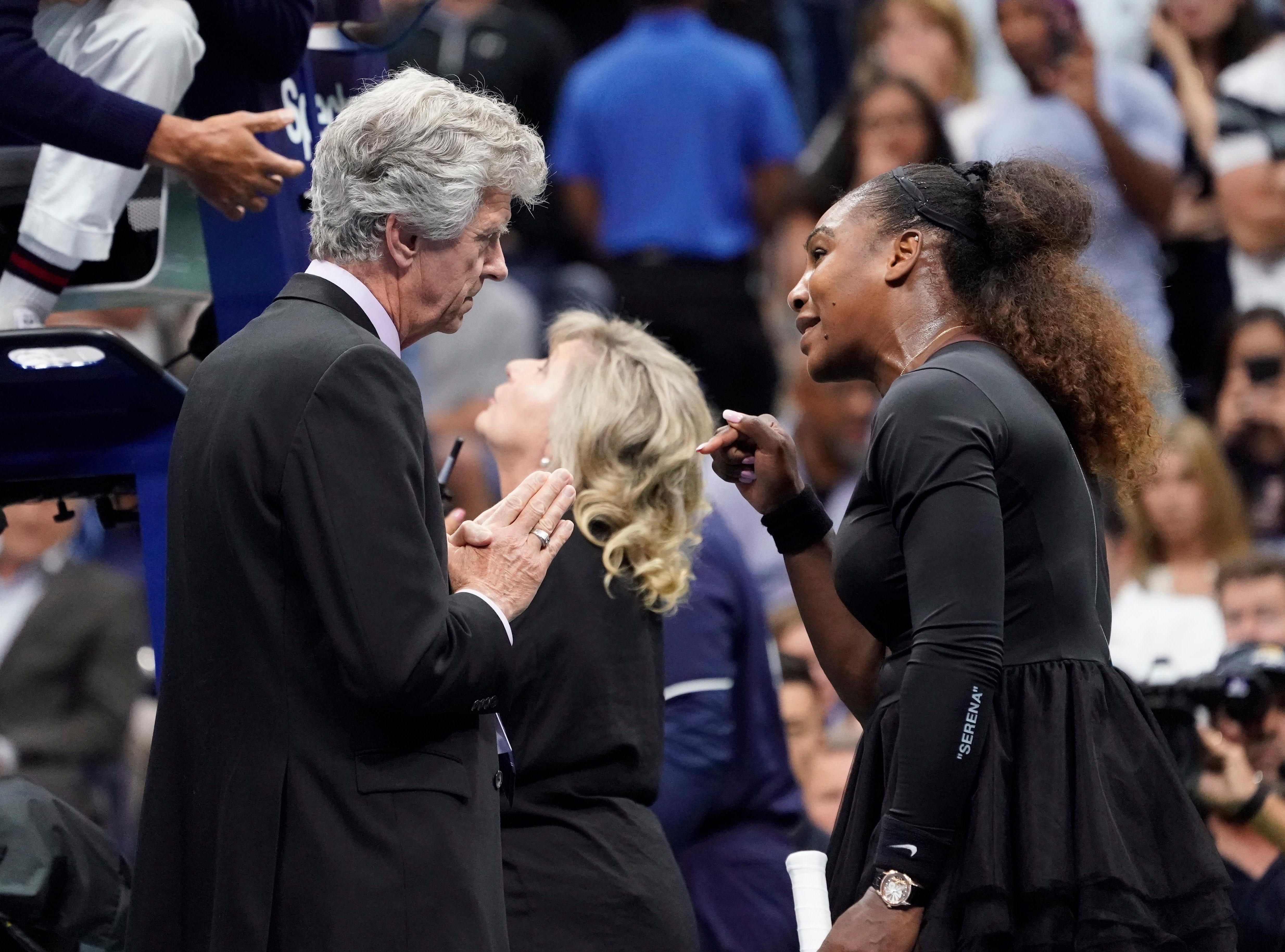Serena Williams argues with tournament director Brian Earley after being assessed a game penalty. She was penalized for arguing with the chair umpire.