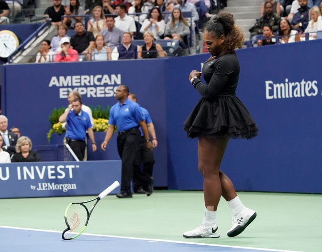Serena Williams smashes her racket after losing a game to Naomi Osaka in the US Open women's final.