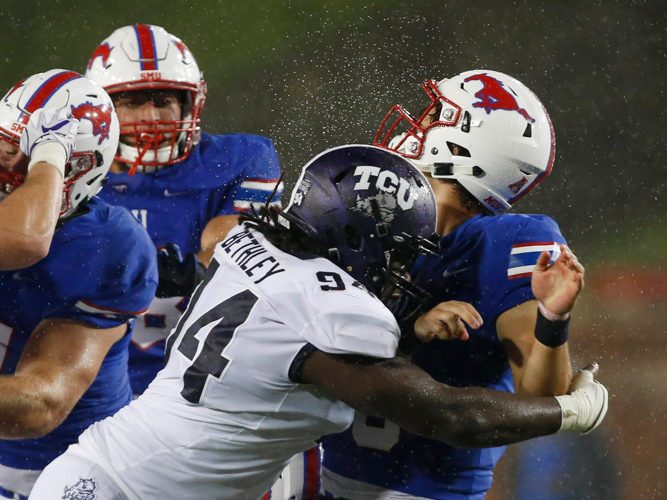 Southern Methodist Mustangs quarterback Ben Hicks (8) is hit by TCU Horned Frogs defensive tackle Corey Bethley (94) in the second quarter at Gerald J. Ford Stadium.