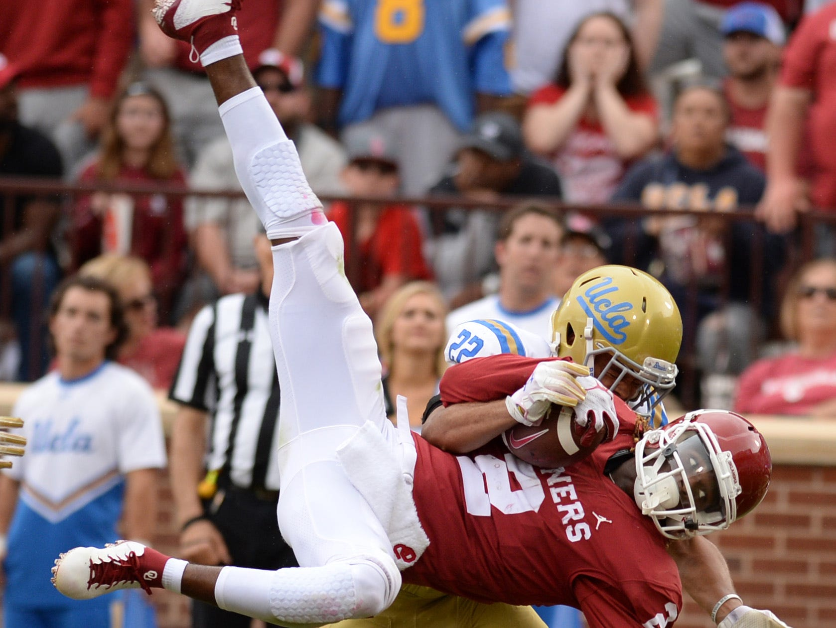 Oklahoma Sooners wide receiver CeeDee Lamb (2) catches a touchdown pass in front of UCLA Bruins defensive back Nate Meadors (22) during the fourth quarter at Gaylord Family - Oklahoma Memorial Stadium.