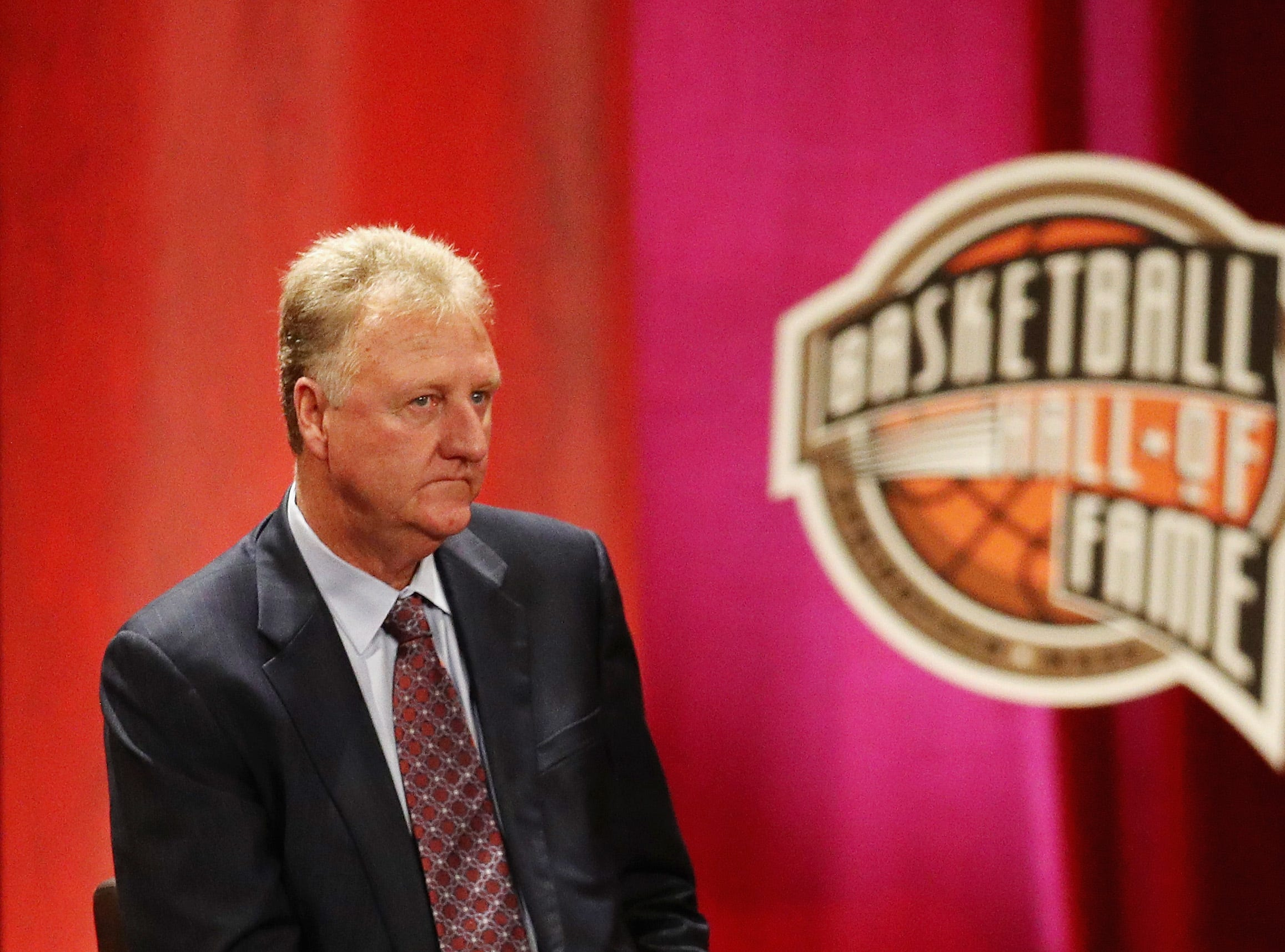 Larry Bird looks on during the 2018 Basketball Hall of Fame Enshrinement Ceremony.