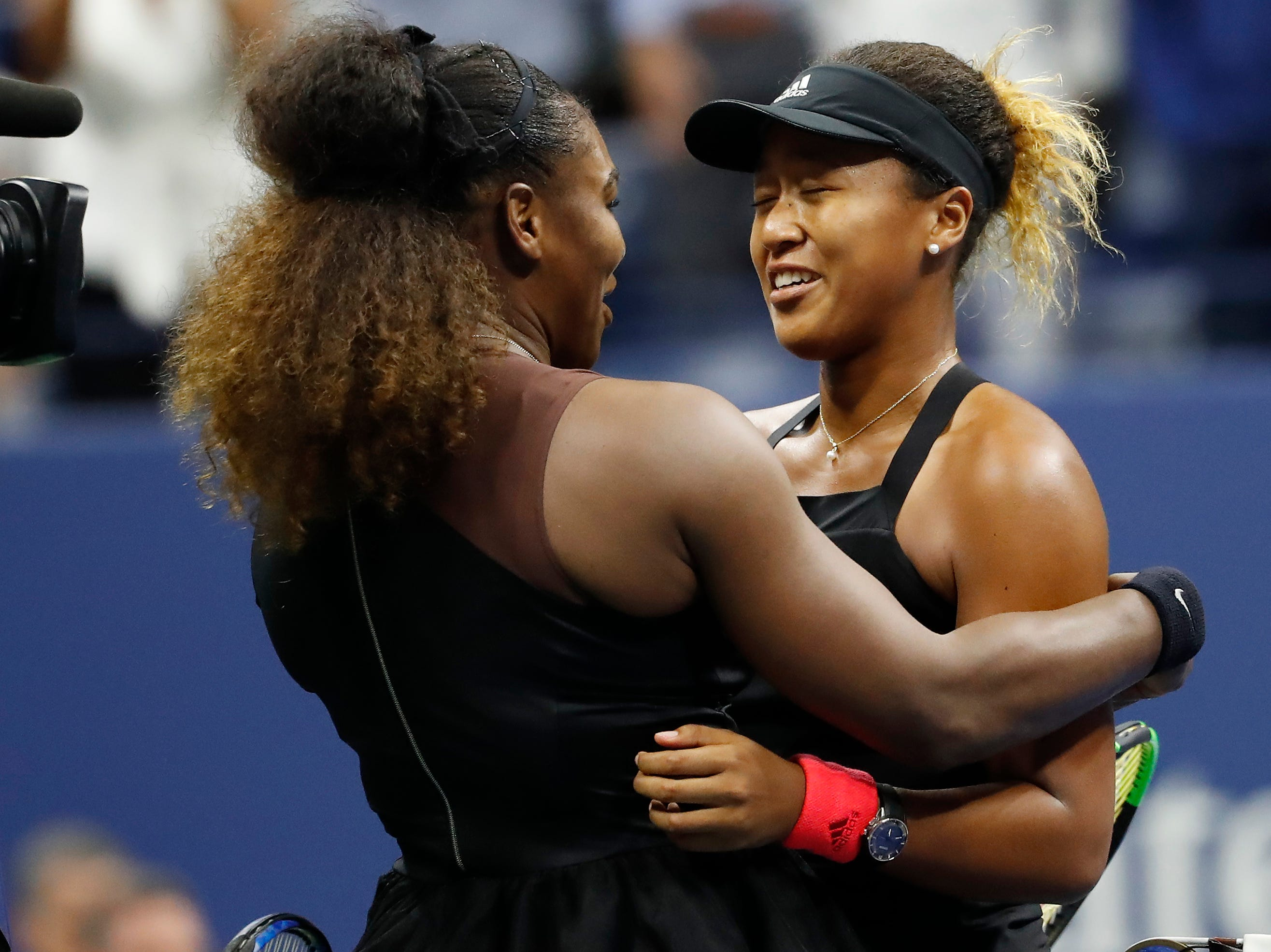 Naomi Osaka, right, won the US Open final 6-2, 6-4 against Serena Williams. Williams was assessed a game penalty in the second set for code violations.