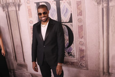 8f939731692fe Kanye West attends the Ralph Lauren fashion show on Sept. 7