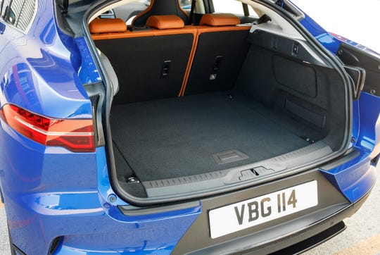 The Jaguar I-PACE features an SUV-style body with ample interior room for passengers (thanks to floor-mounted batteries) as well as a fairly generous for its segment rear trunk area.