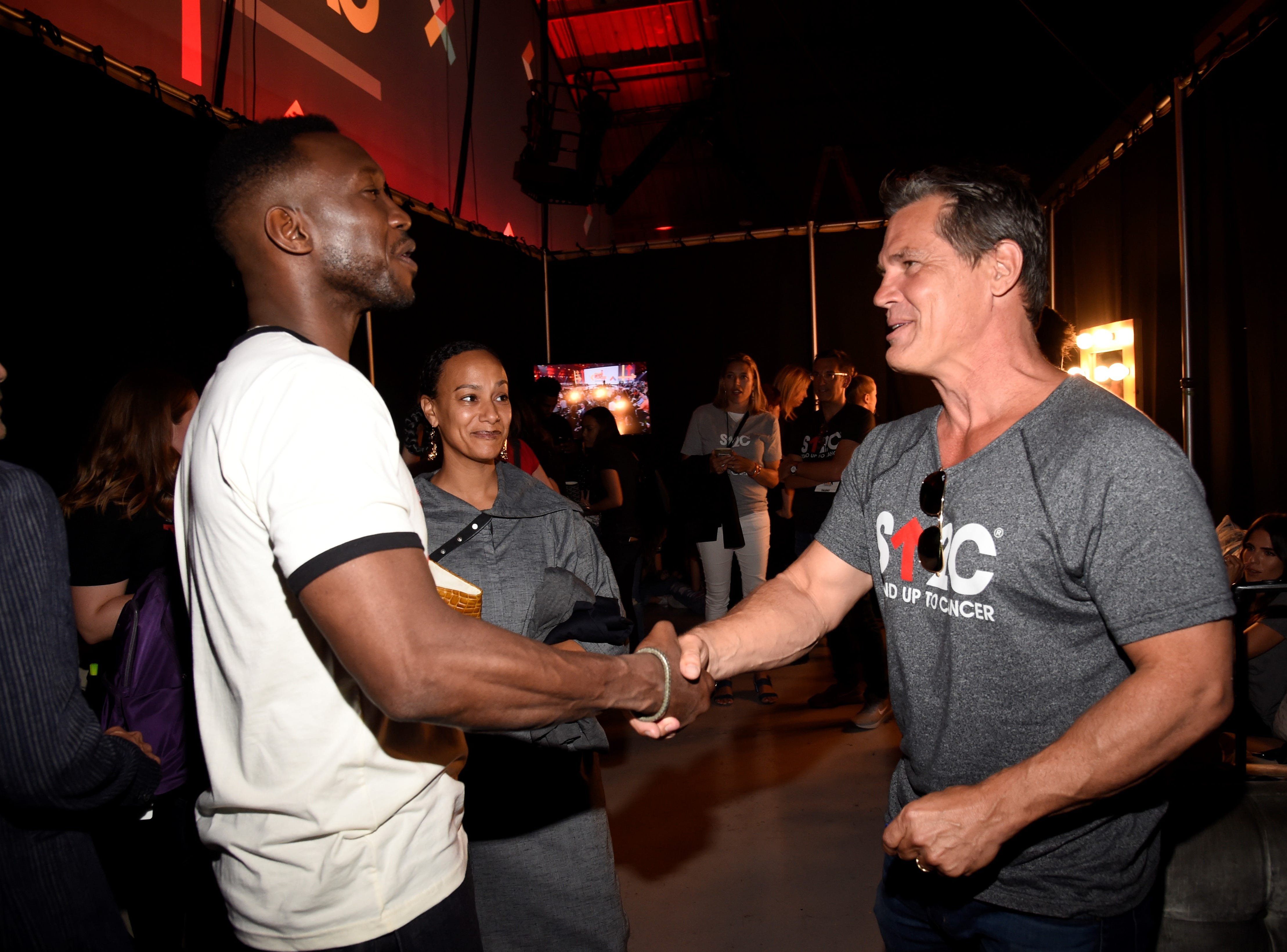 "Mahershala Ali and Josh Brolin give greetings backstage at ""Stand Up  To Cancer."""