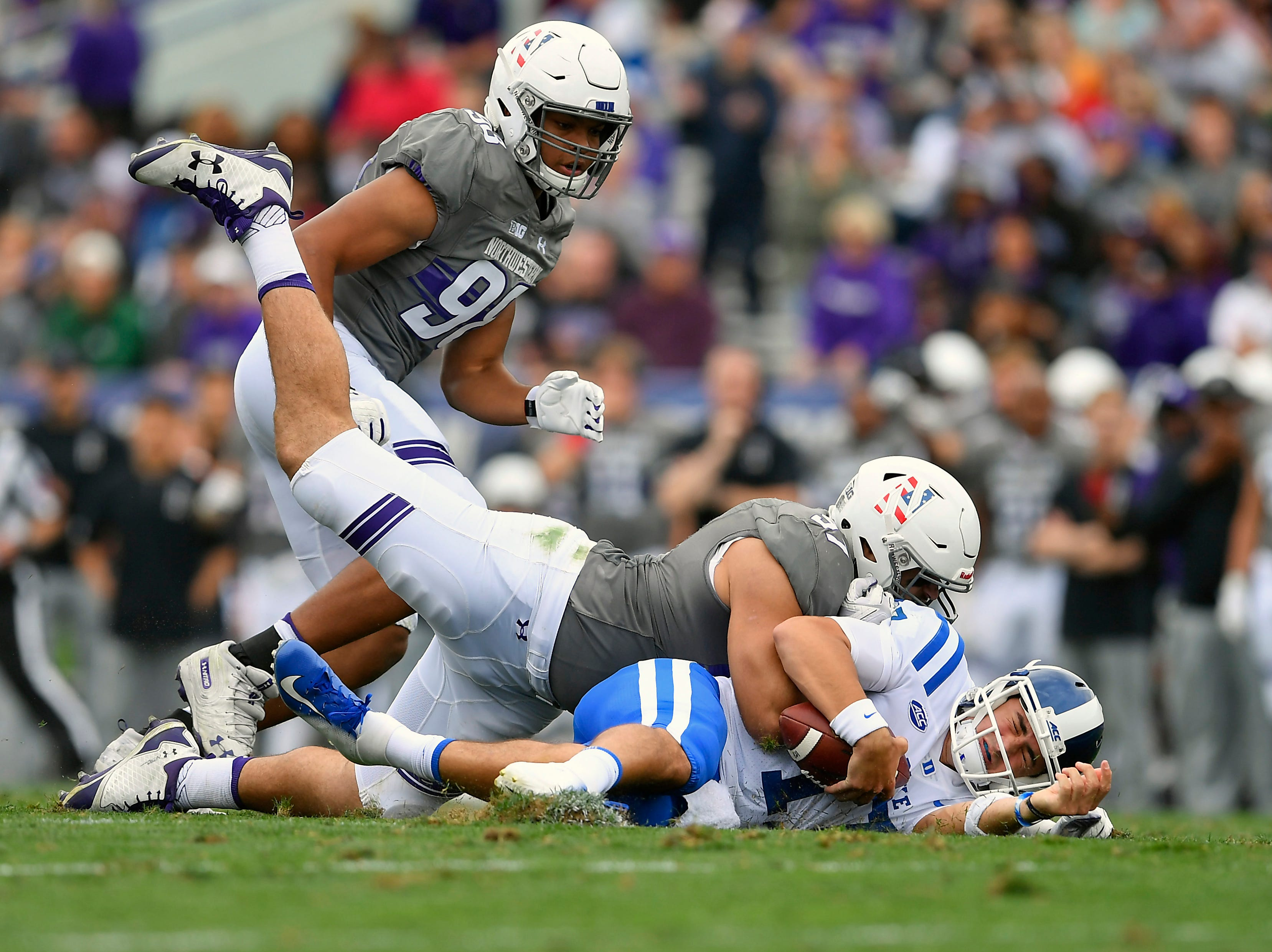 Northwestern Wildcats defensive lineman Joe Gaziano (97) sacks Duke Blue Devils quarterback Daniel Jones (17) in the second half at Ryan Field.