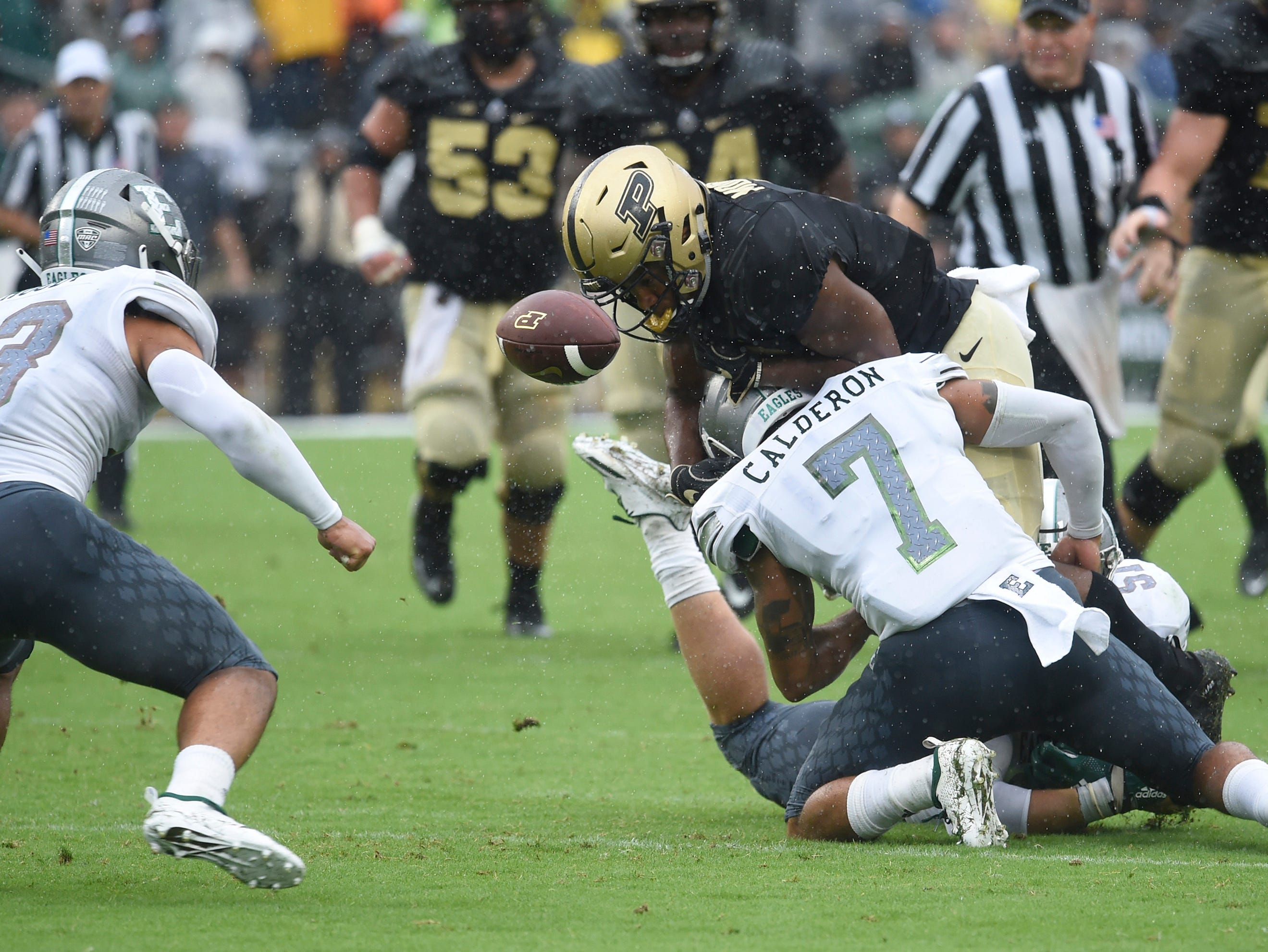 Purdue Boilermakers running back D.J. Knox (1) fumbles the ball in the first half against Eastern Michigan Eagles defensive back Ikie Calderon (7) at Ross-Ade Stadium.