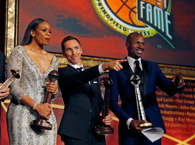 Tina Thompson, Steve Nash and Ray Allen look out to the audience after ceremonies at the Basketball Hall of Fame.