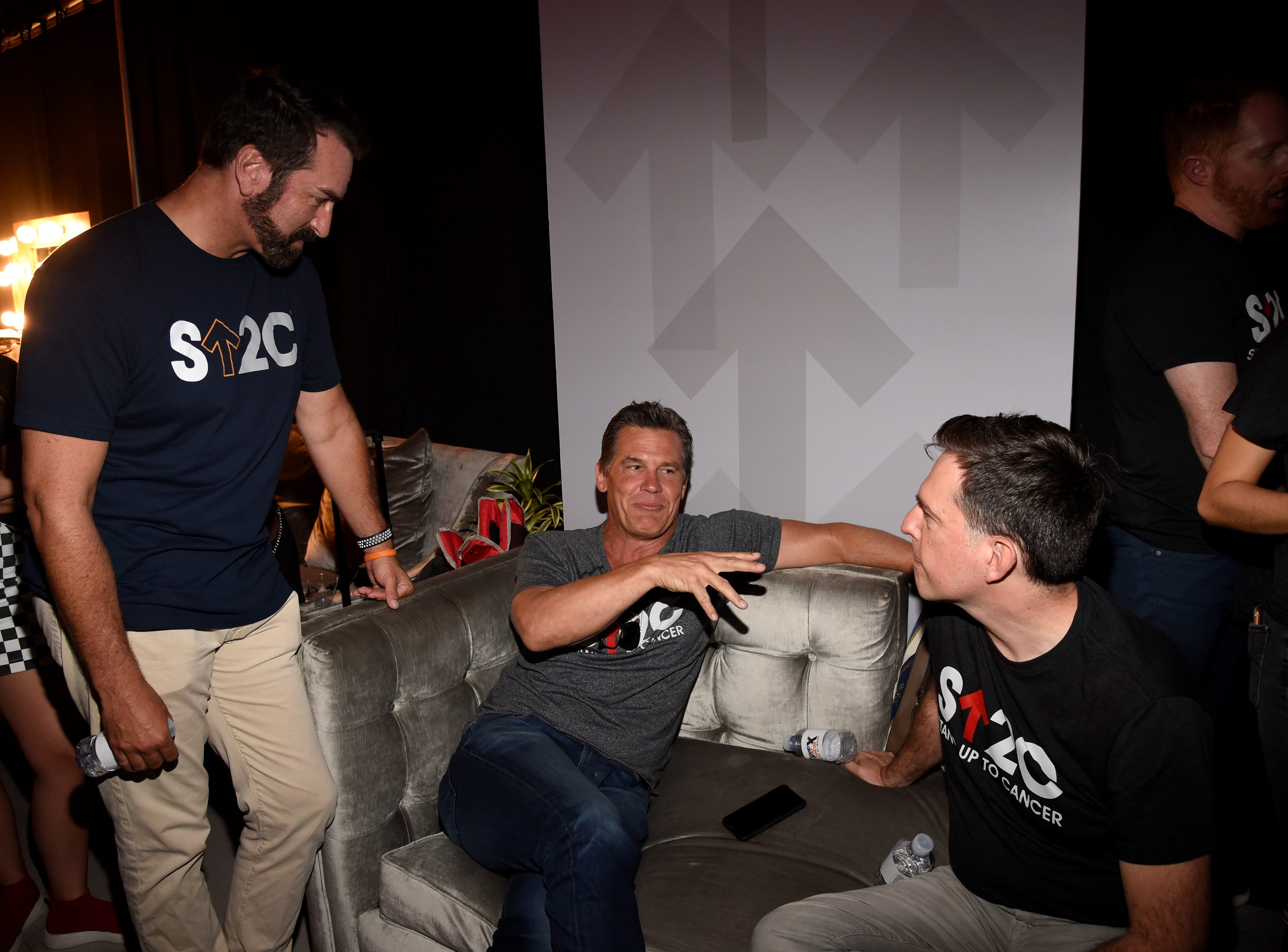 "Rob Riggle, Josh Brolin and Ed Helms chat backstage at the ""Stand Up To Cancer"" telethon on Friday night."