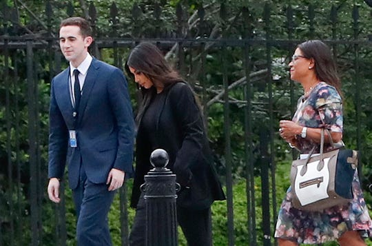 Kim Kardashian, center, arrives May 30, 2018, with her attorney Shawn Chapman Holley at the security entrance of the White House.