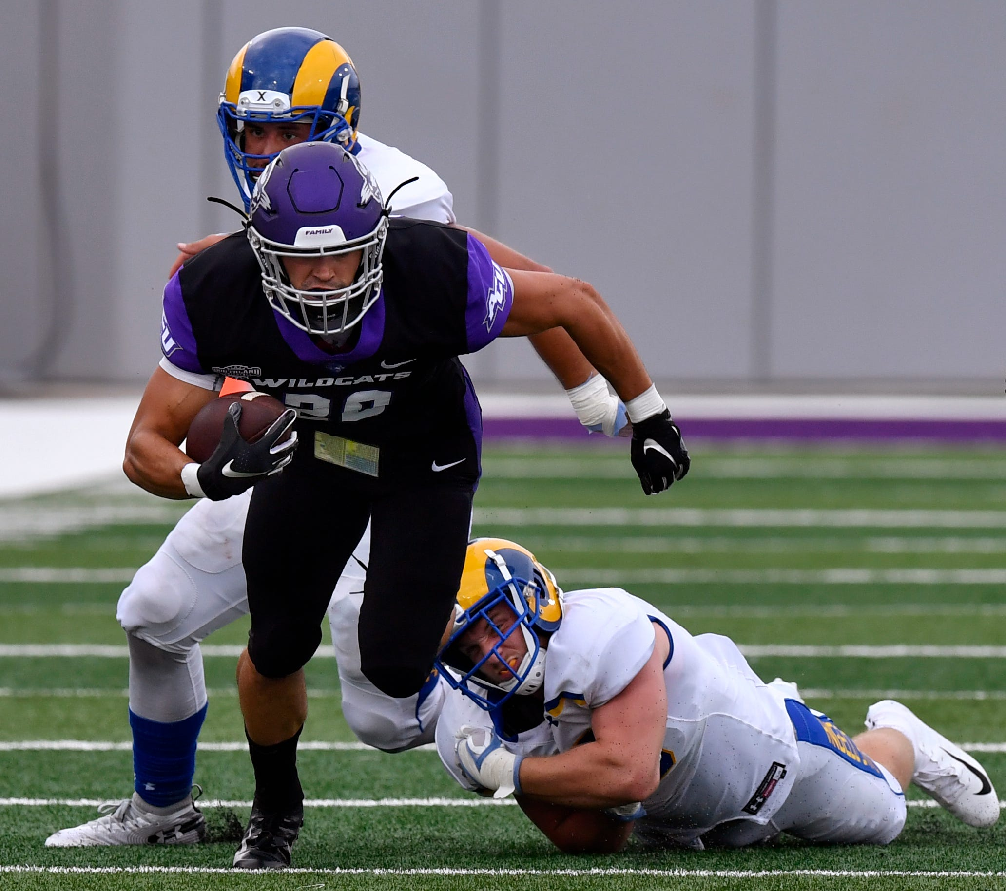 ACU's running back Billy McCrary breaks a tackle as he gains yardage against Angelo State on Sept. 8 at Wildcat Stadium.