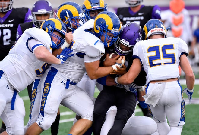 The Angelo State defense swarms Abilene Christian's Sema'J Davis during the Wildcats' 41-24 win at Wildcat Stadium on Saturday, Sept. 8, 2018. The Rams host Texas A&M-Kingsville in their Lone Star Conference opener at 6 p.m. Saturday, Sept. 15.