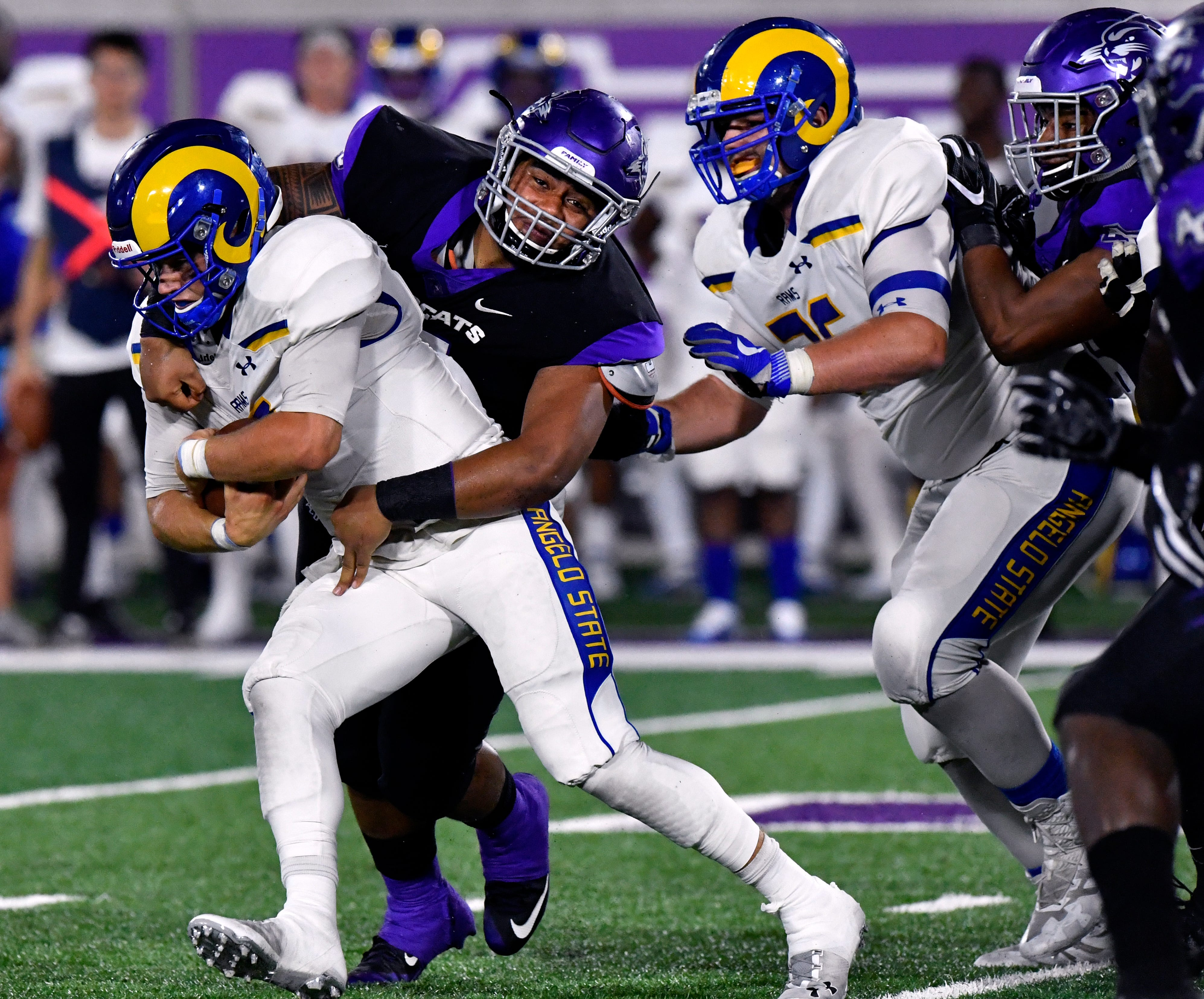 Abilene Christian defensive tackle Makoni Pole sacks Angelo State quarterback Charlie Rotherman during Saturday's game at Wildcat Stadium on Sept. 8, 2018. The Wildcats held off the Rams 41-24.