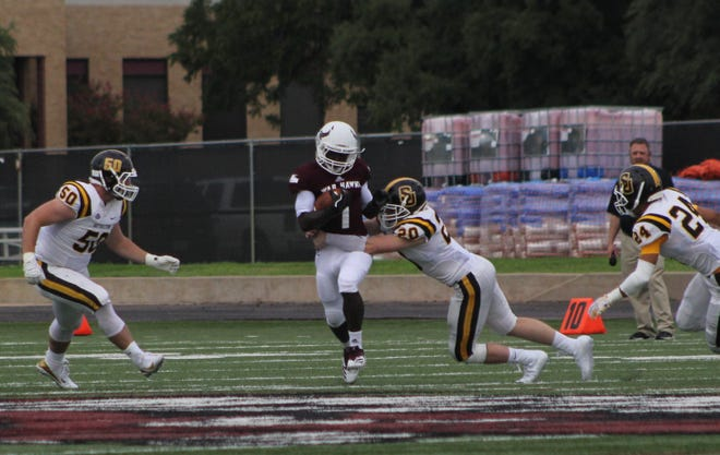 Eriel Dorsey (1) breaks a tackle during the first half of McMurry's ASC conference opener against Southwestern on Saturday at Wilford Moore Stadium. The War Hawks lost their second game at home, falling 37-6.