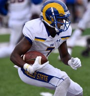 Angelo State University wide receiver Larry Johnson carries the ball during the Rams' game against Abilene Christian University in Abilene Saturday Sept. 8, 2018. Final score was 41-24, ACU.