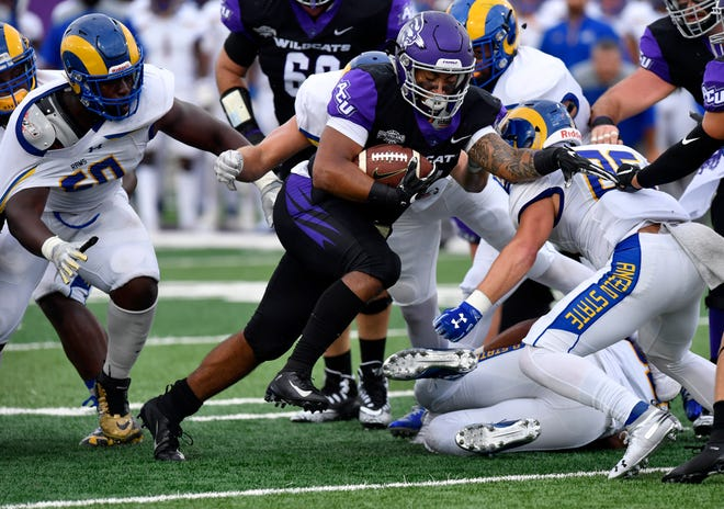 ACU running back Tracy James gains yardage during the Wildcats' game against Angelo State University Saturday Sept, 8, 2018.