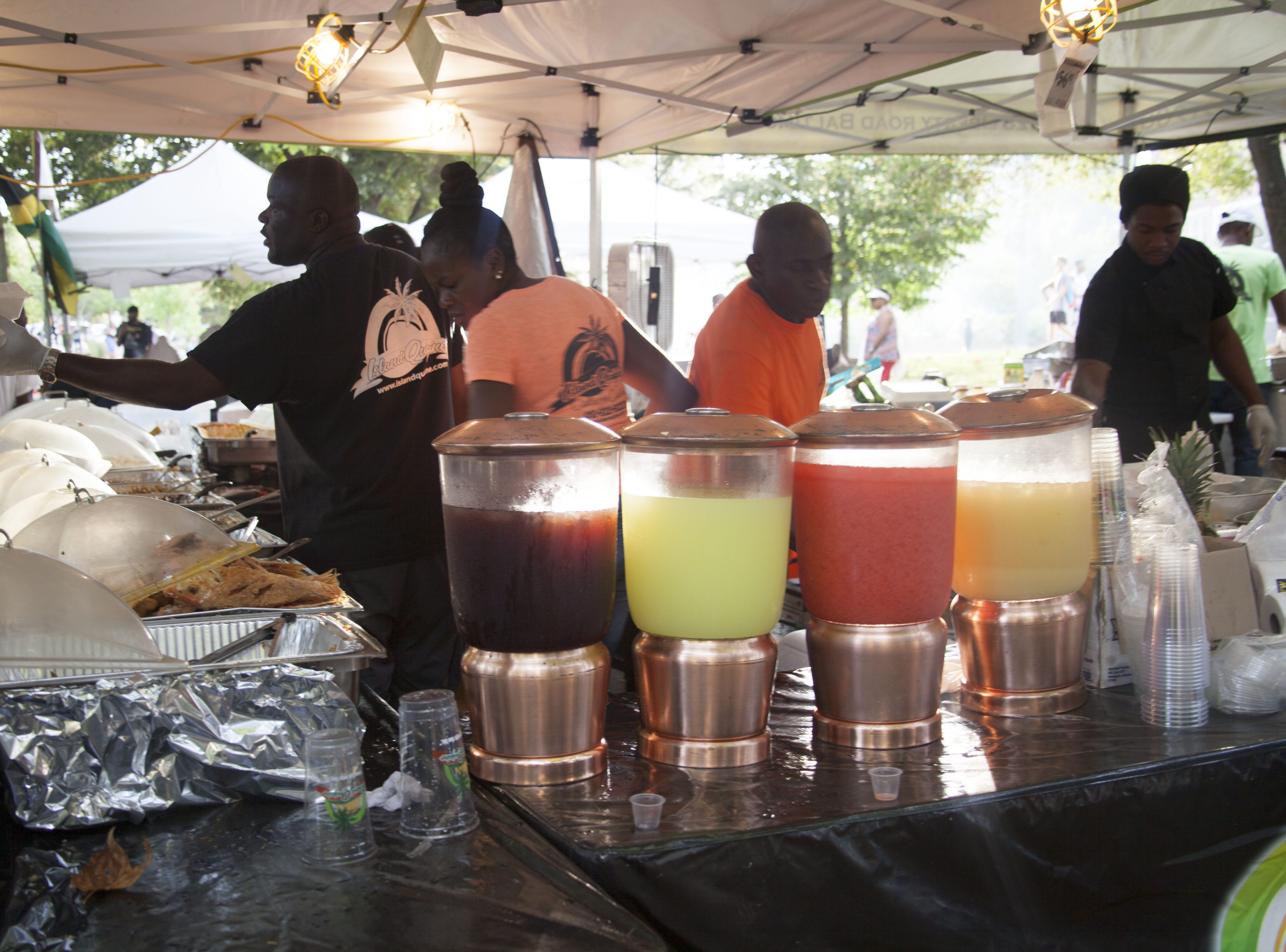 Island Quizine serves Jamaican fare to attendees of the 2018 Goombay Festival at the Roger McGuire Green in Pack Square Park on Sept. 8, 2018.