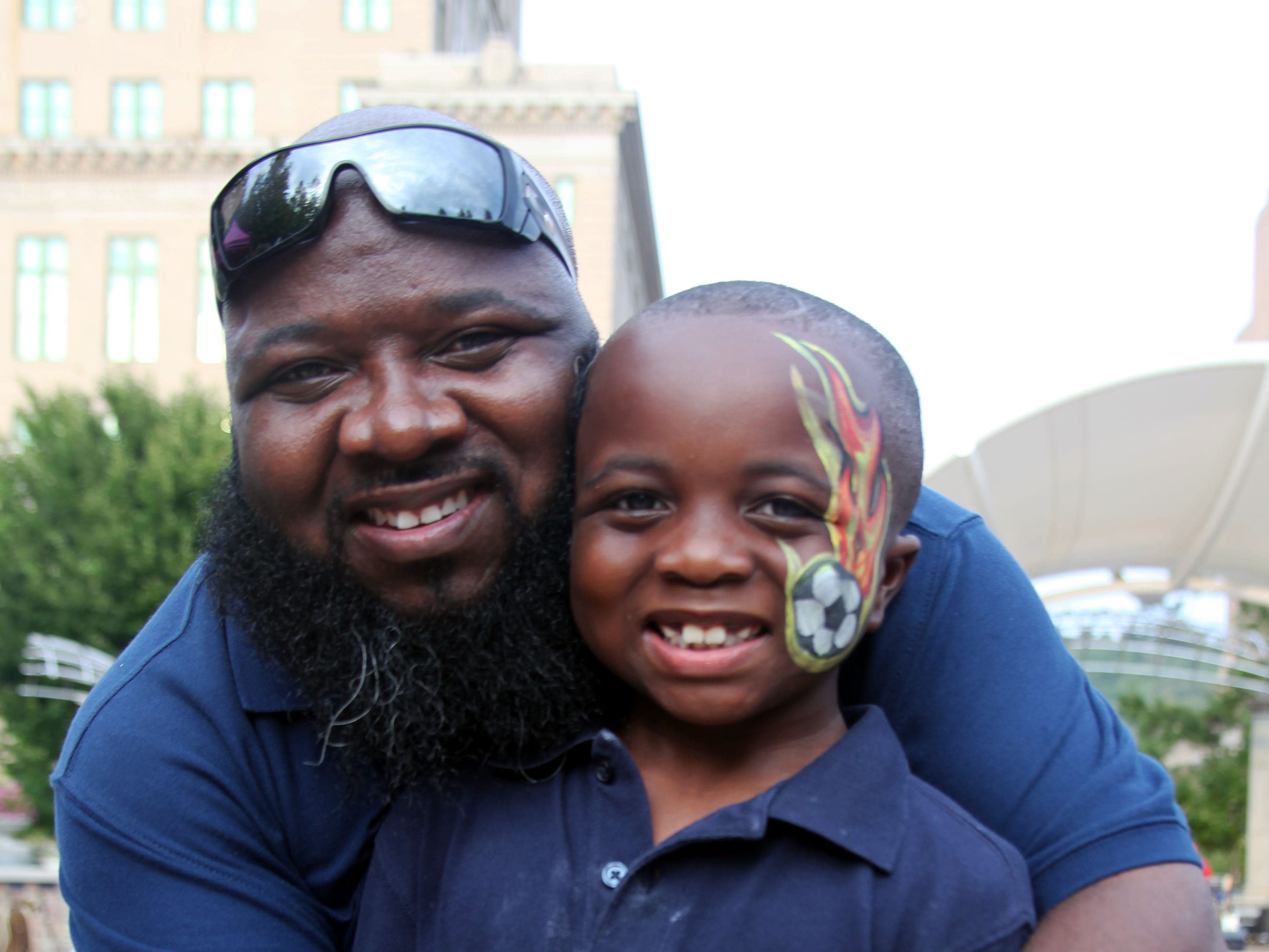 Bo and Derick Bennett enjoy the 2018 Goombay Festival at the Roger McGuire Green in Pack Square Park on Sept. 8, 2018.