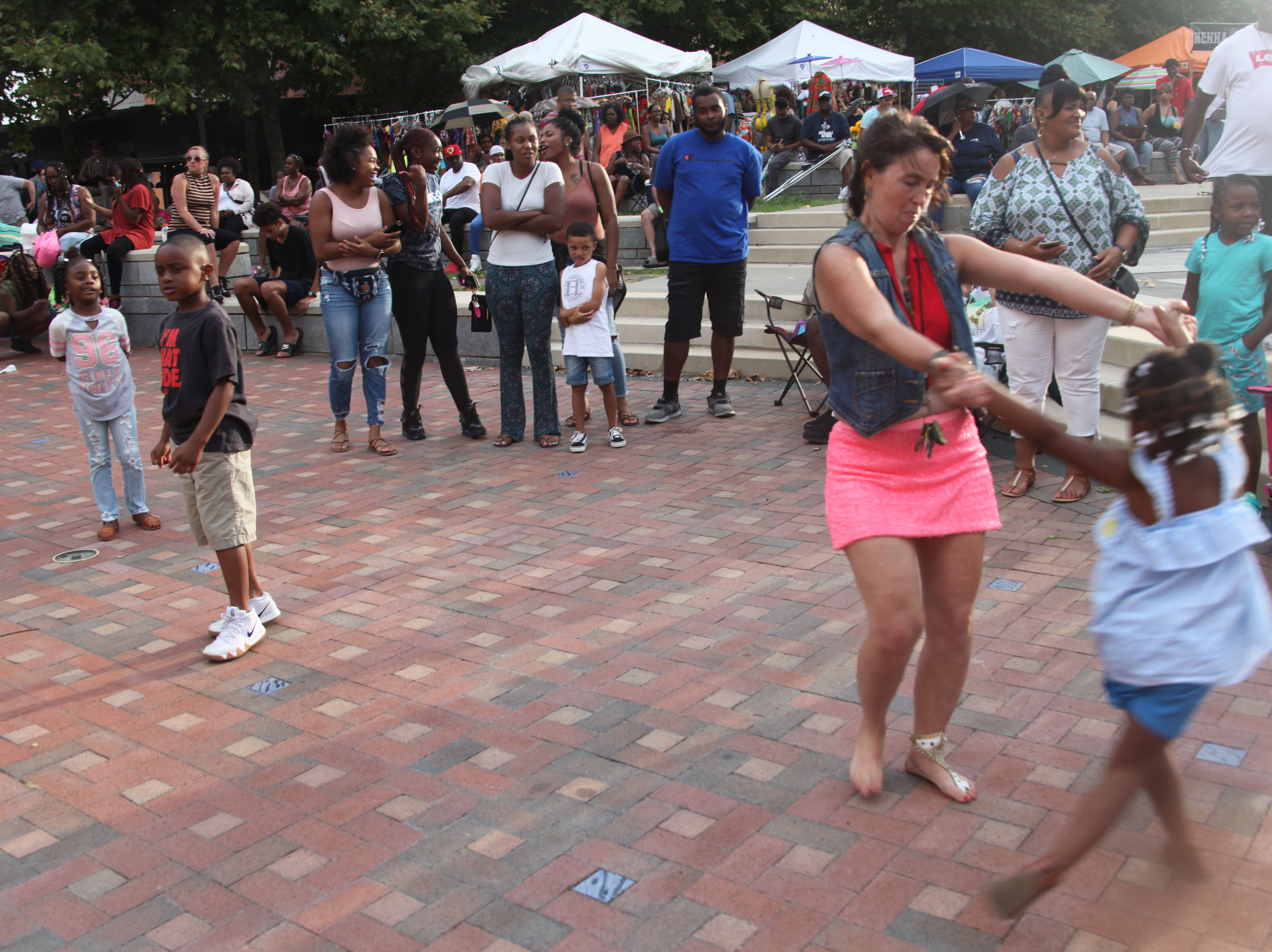 Heidi Dorf dances at the 2018 Goombay Festival at the Roger McGuire Green in Pack Square Park on Sept. 8, 2018.