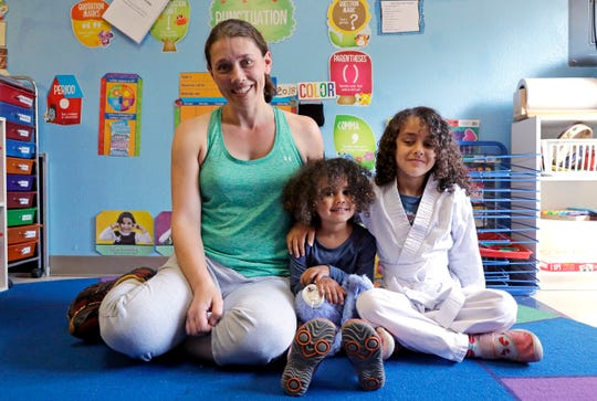 Rachel Lipsky, left, poses with her daughters Azra Maidadi, center, and Naima Maidadi at Azra's preschool and where Naima previously attended in Shoreline. Lipsky and her husband were already at a disadvantage when they started looking for child care while she was pregnant in 2012. The 38-year-old project manager discovered it wasn't a problem they could solve with money, given they were in an already-expensive market that charges about $2,000 monthly per child. They eventually secured a spot for their girls, but the road to preschool was daunting, emotional, time-consuming and pricy.