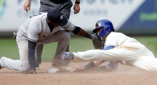 The Mariners' Mitch Haniger steals second before the tag from New York Yankees shortstop Adeiny Hechavarria during the eighth inning. Hanger went on to score the winning run.
