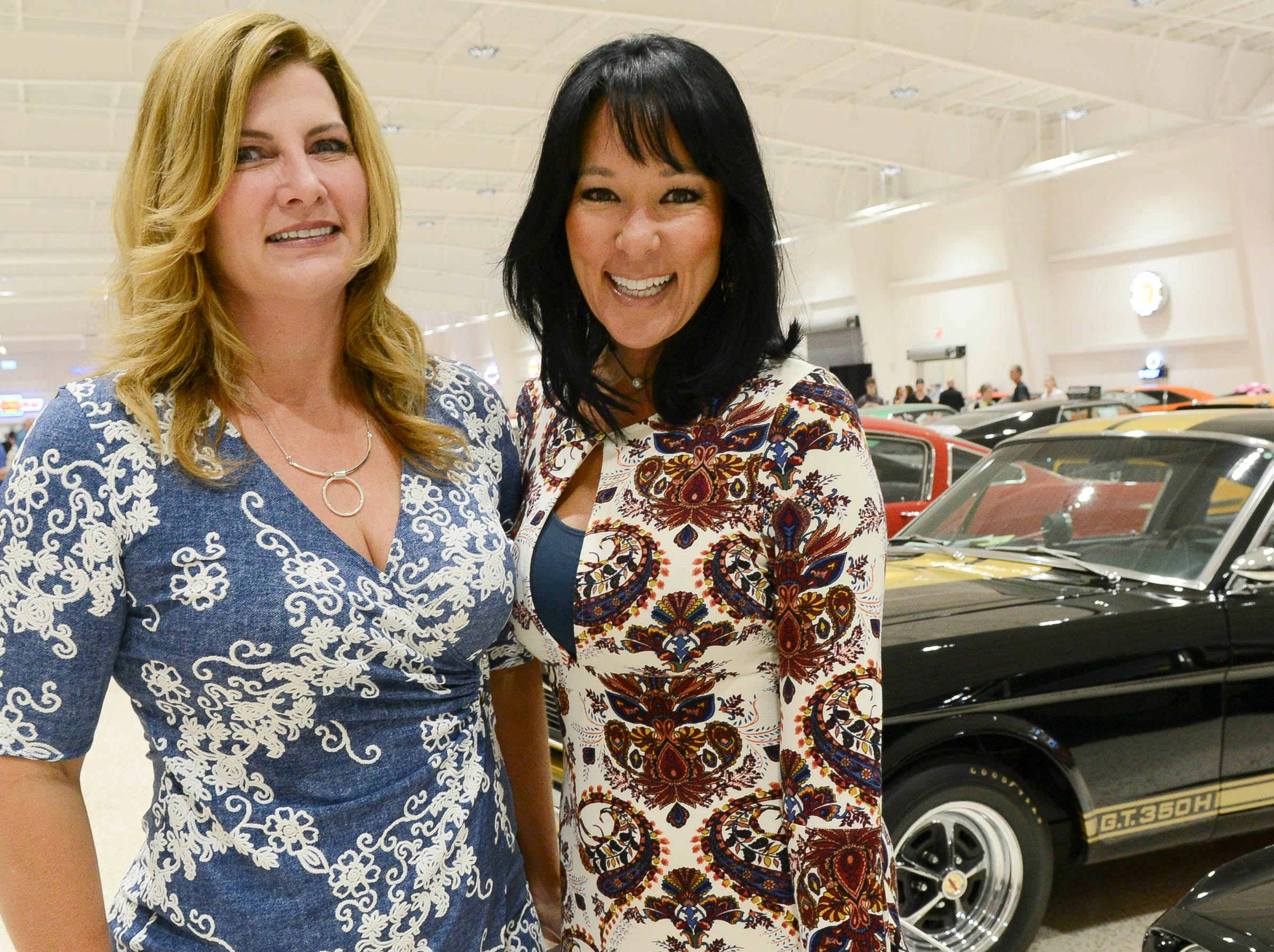 Julie King and Jennifer Gordon get their picture taken during the Stars and Stripes fundraiser at American Muscle Car Museum. The event was a fundraiser for Space Coast Honor Flight.