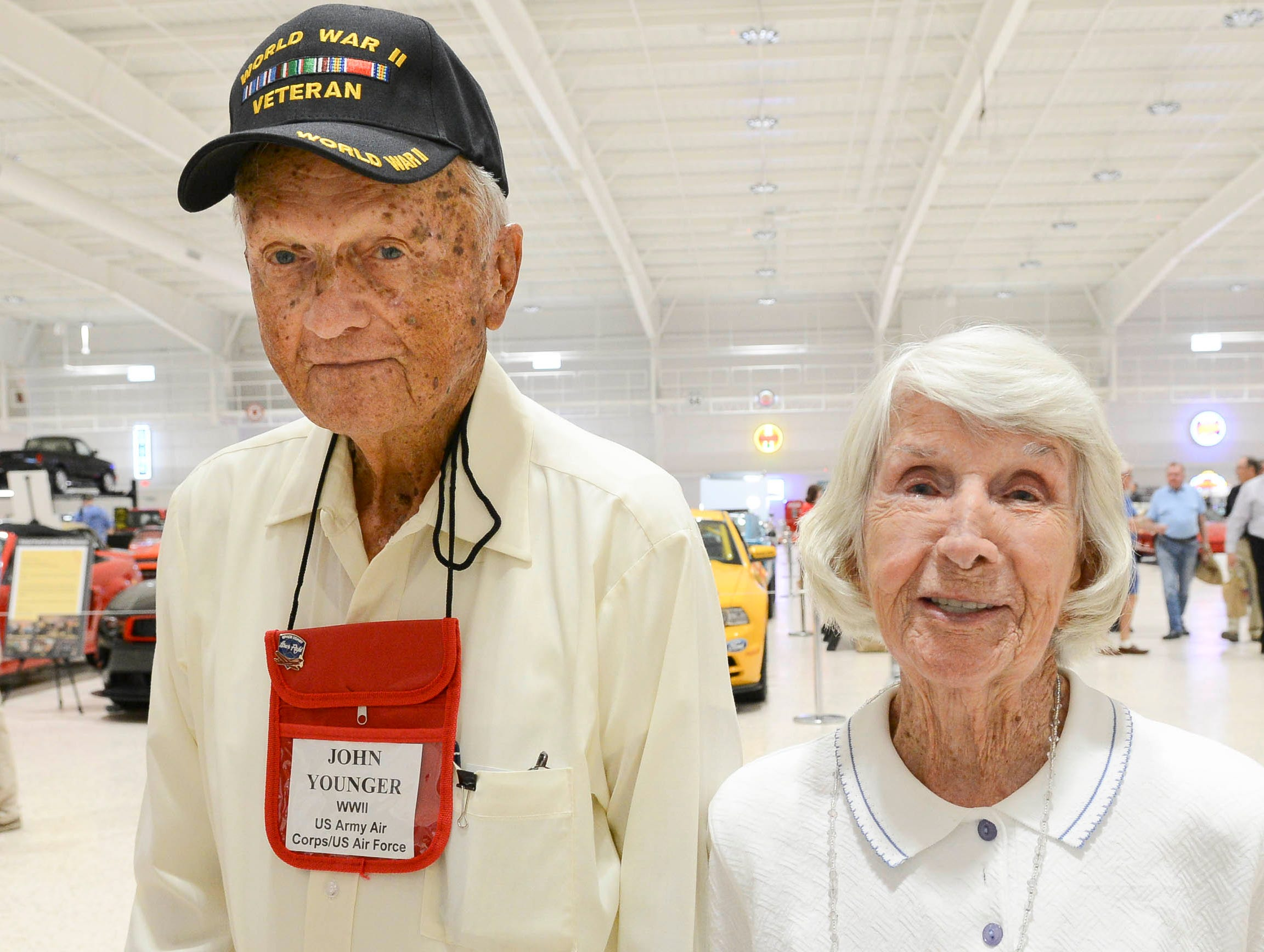 John and Helen Younger get their picture taken during the Stars and Stripes fundraiser at American Muscle Car Museum. The event was a fundraiser for Space Coast Honor Flight.