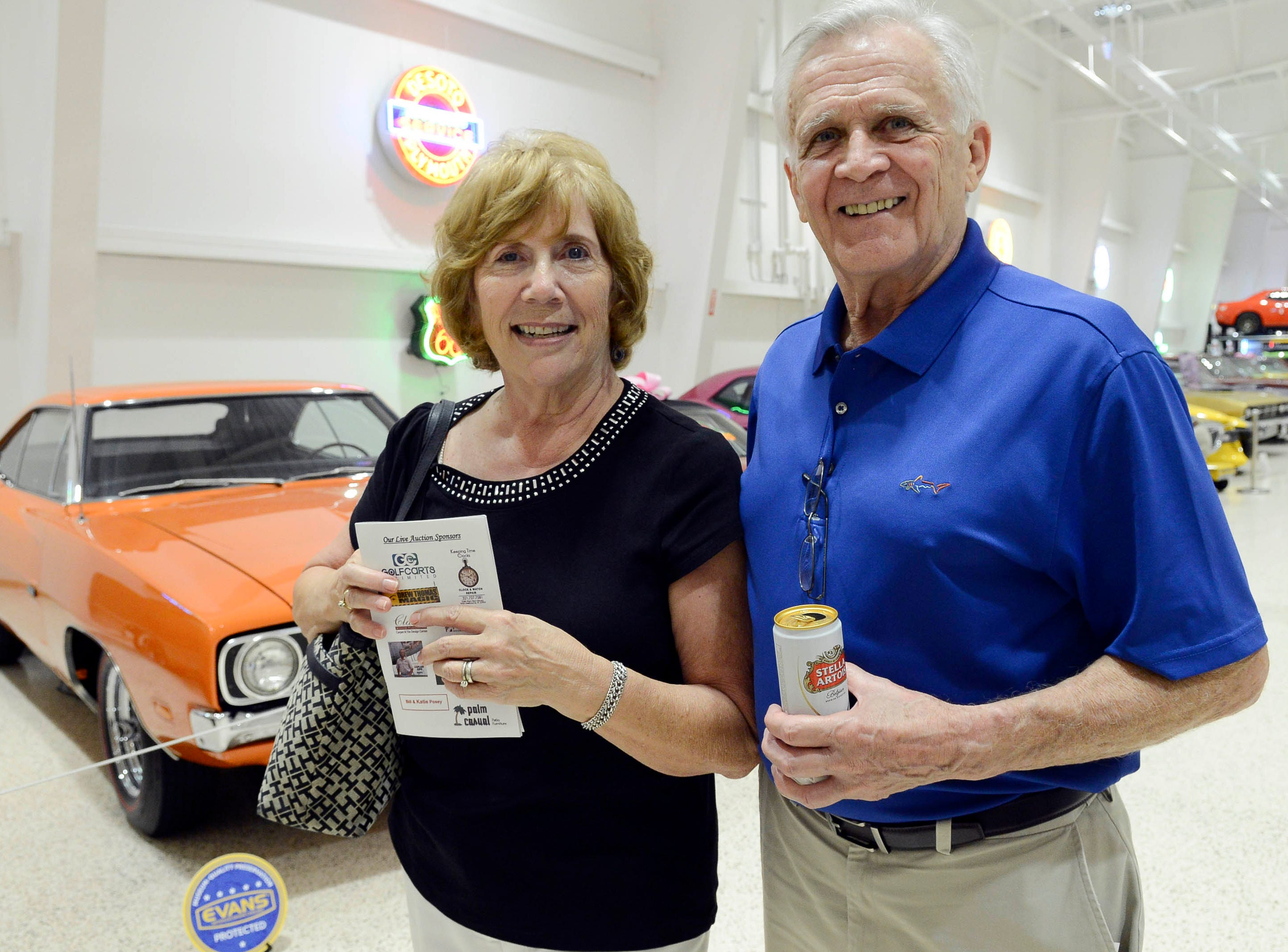 Carol and Herb McElrath get their picture taken during the Stars and Stripes fundraiser at American Muscle Car Museum. The event was a fundraiser for Space Coast Honor Flight.
