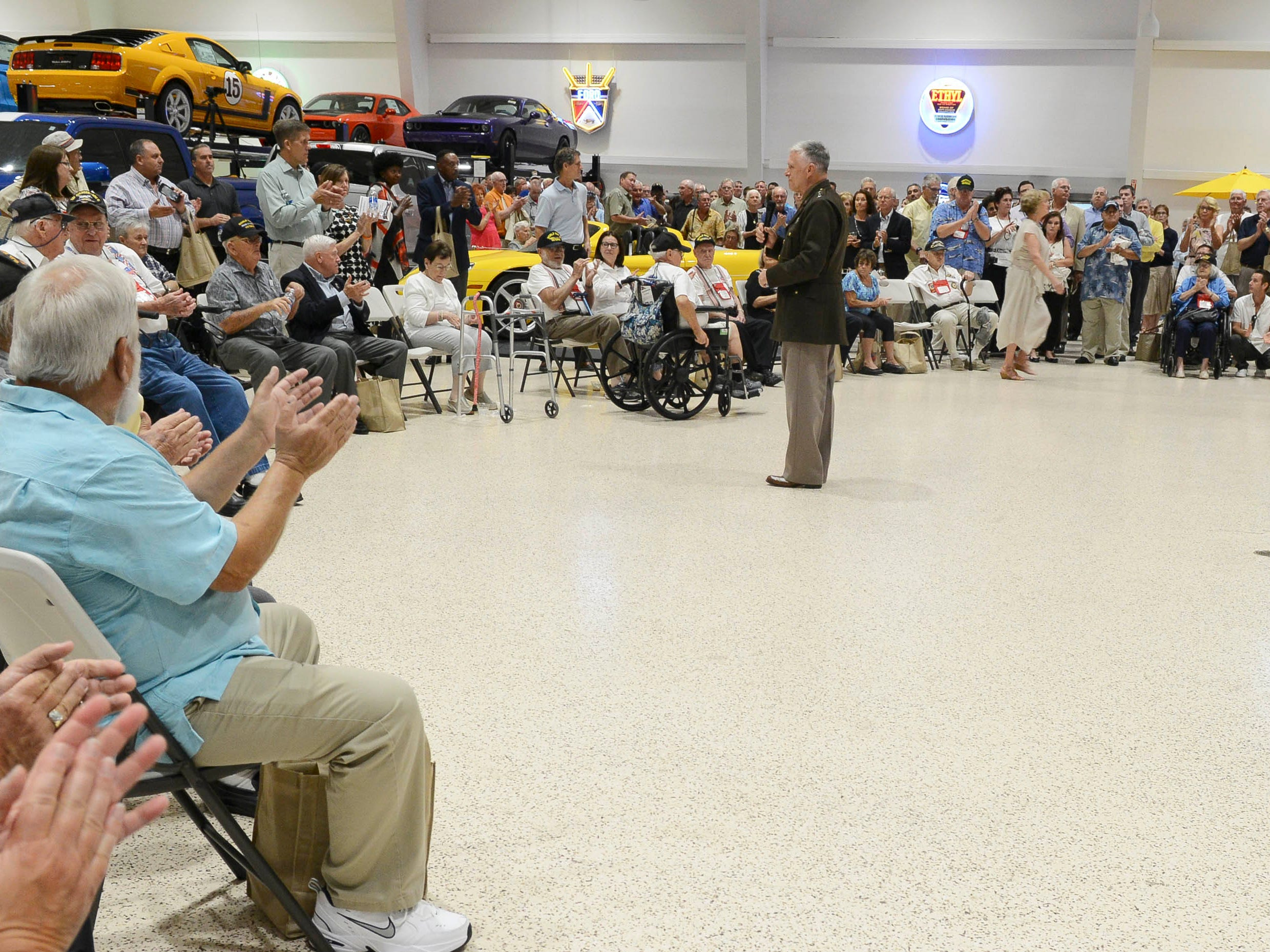 Bill Weiser, president of Space Coast Honor Flight, addresses the during Stars and Stripes fundraiser at American Muscle Car Museum. The event was a fundraiser for Space Coast Honor Flight.