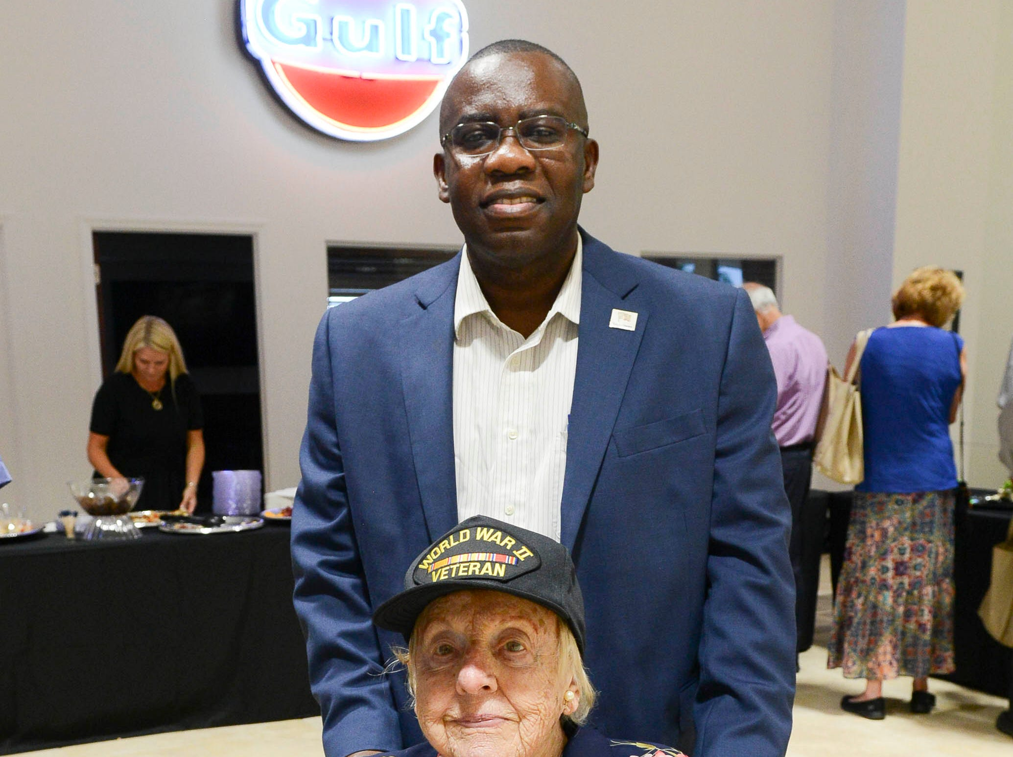 Bobbie Schwartz and Chad Fertil get their picture taken during the Stars and Stripes fundraiser at American Muscle Car Museum. The event was a fundraiser for Space Coast Honor Flight.