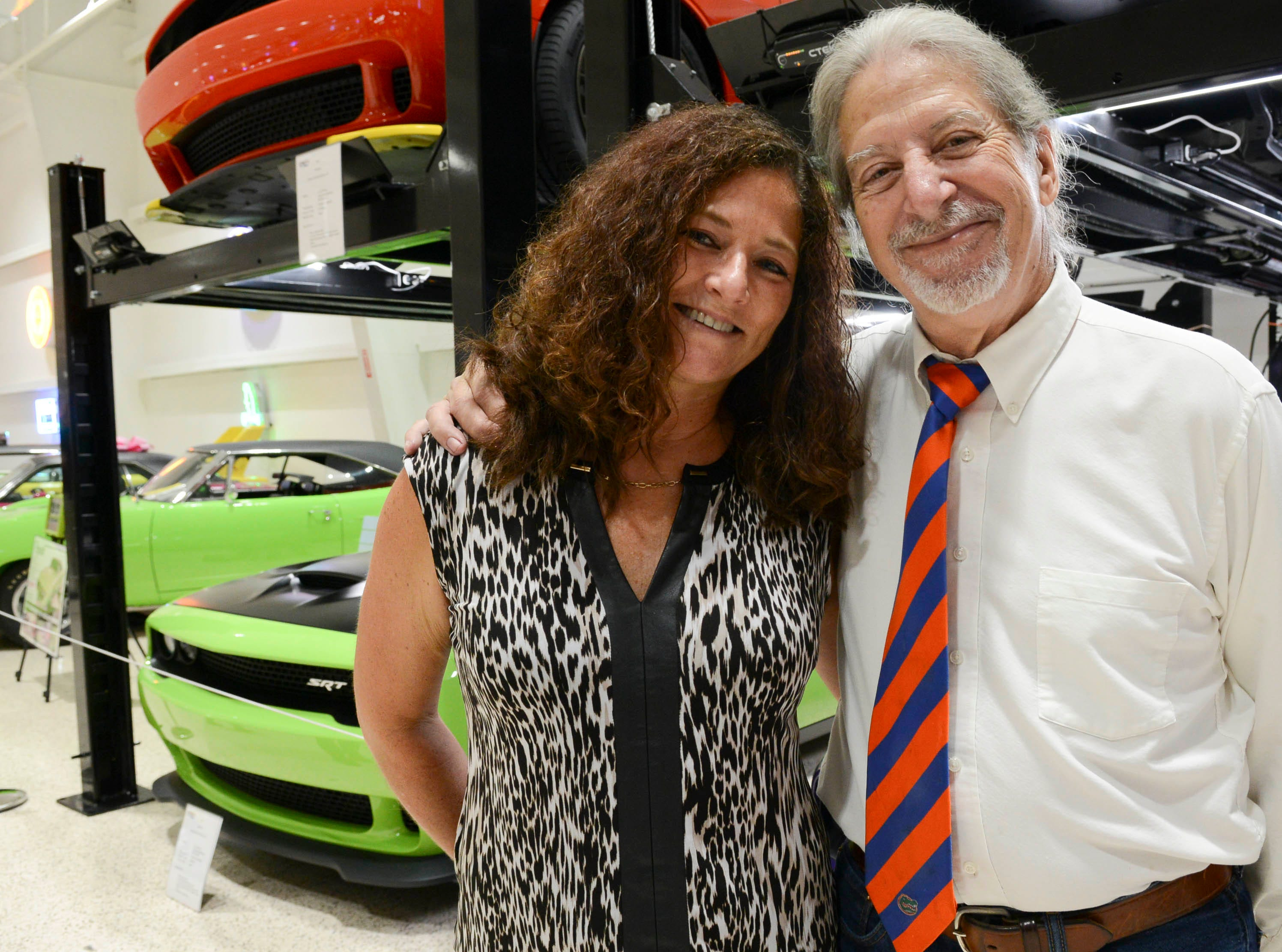 Liz Allen and Lloyd Behrendt get their picture taken during the Stars and Stripes fundraiser at American Muscle Car Museum. The event was a fundraiser for Space Coast Honor Flight.