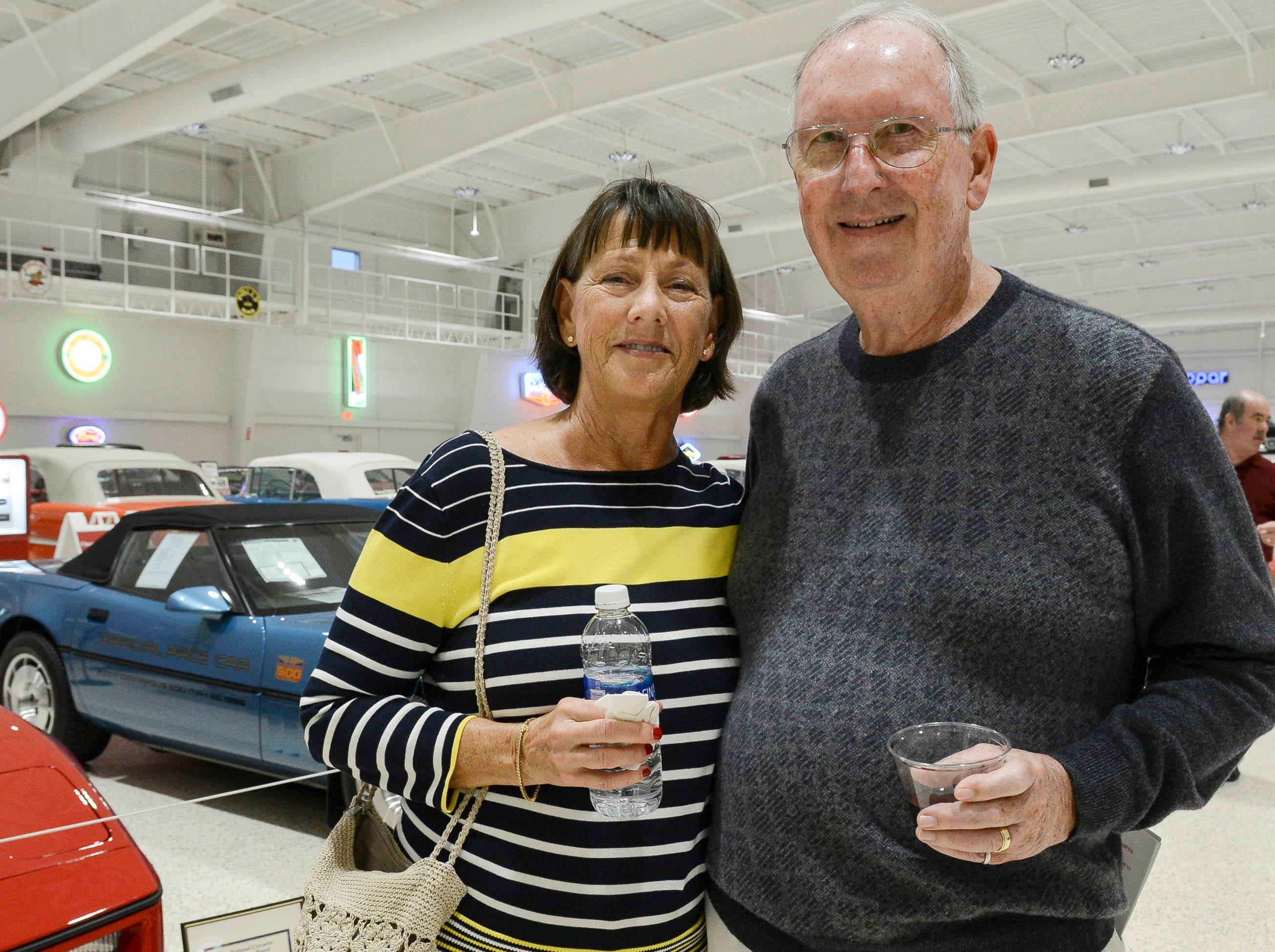 Donna and Larry Fruit get their picture taken during the Stars and Stripes fundraiser at American Muscle Car Museum. The event was a fundraiser for Space Coast Honor Flight.