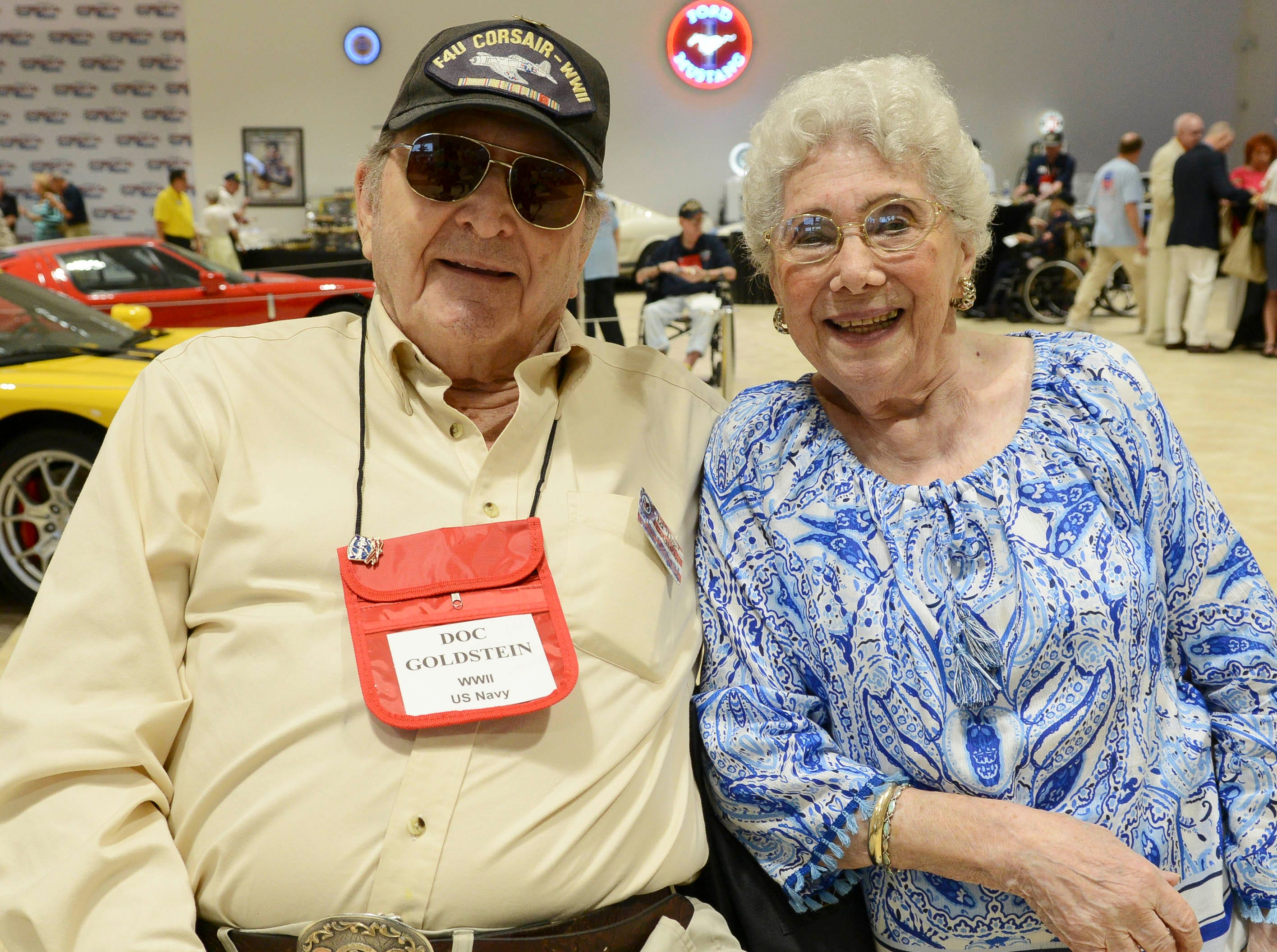 Don and Anne Goldstein get their picture taken during the Stars and Stripes fundraiser at American Muscle Car Museum. The event was a fundraiser for Space Coast Honor Flight.