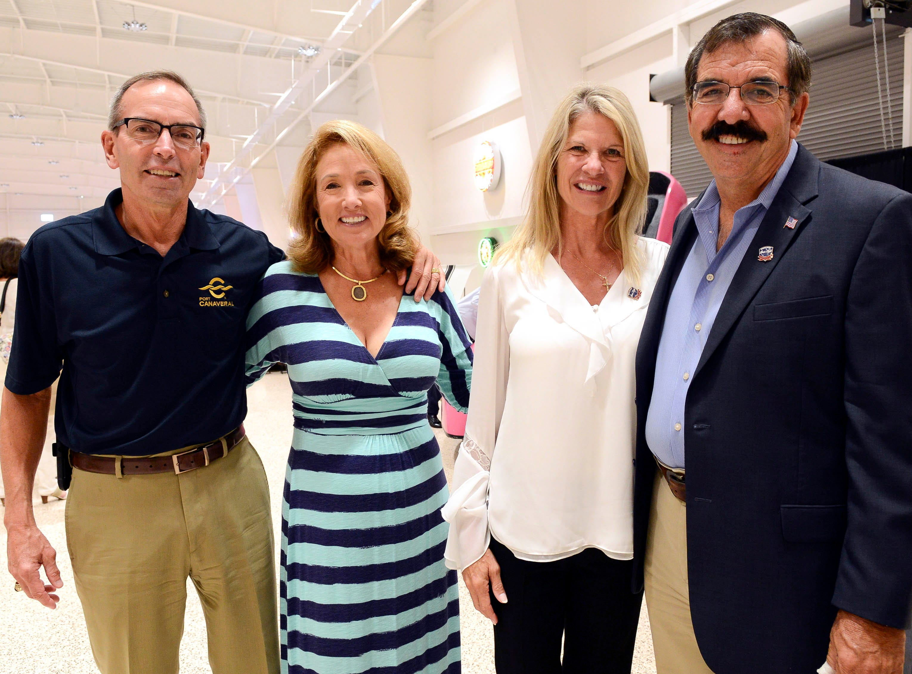 Port Canaveral Commission Chairman Wayne Justice and his wife Barbara and State senator Debbie Mayfield and her husband Bob Scaringe get their picture taken during the Stars and Stripes fundraiser at American Muscle Car Museum. The event was a fundraiser for Space Coast Honor Flight.
