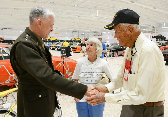 Bill Weiser of Space Coast Honor Flight says hello to Helen and John Younger Saturday during Stars and Stripes at American Muscle Car Museum. The event was a fundraiser for Space Coast Honor Flight.