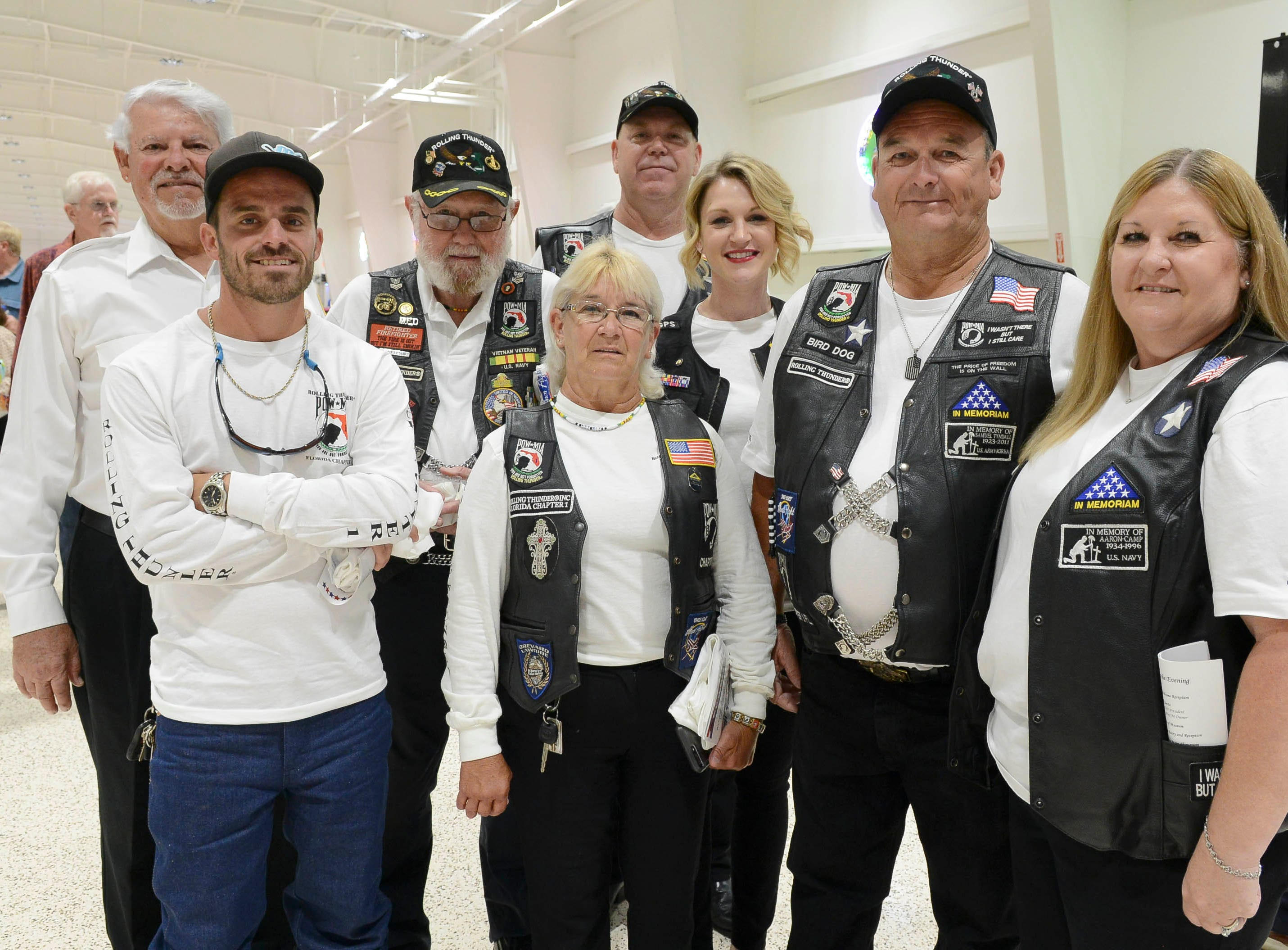 Members of the Rolling Thunder group get their picture taken during the Stars and Stripes fundraiser at American Muscle Car Museum. The event was a fundraiser for Space Coast Honor Flight.