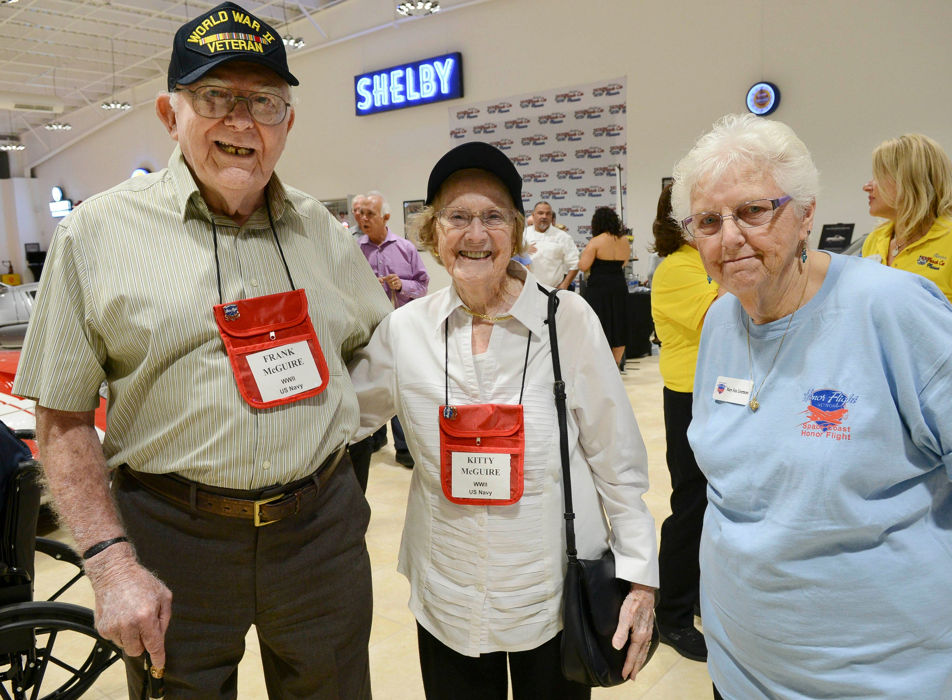 Francis and Kathleen McGuire and Mary Ann Livermore get their picture taken during the Stars and Stripes fundraiser at American Muscle Car Museum. The event was a fundraiser for Space Coast Honor Flight.