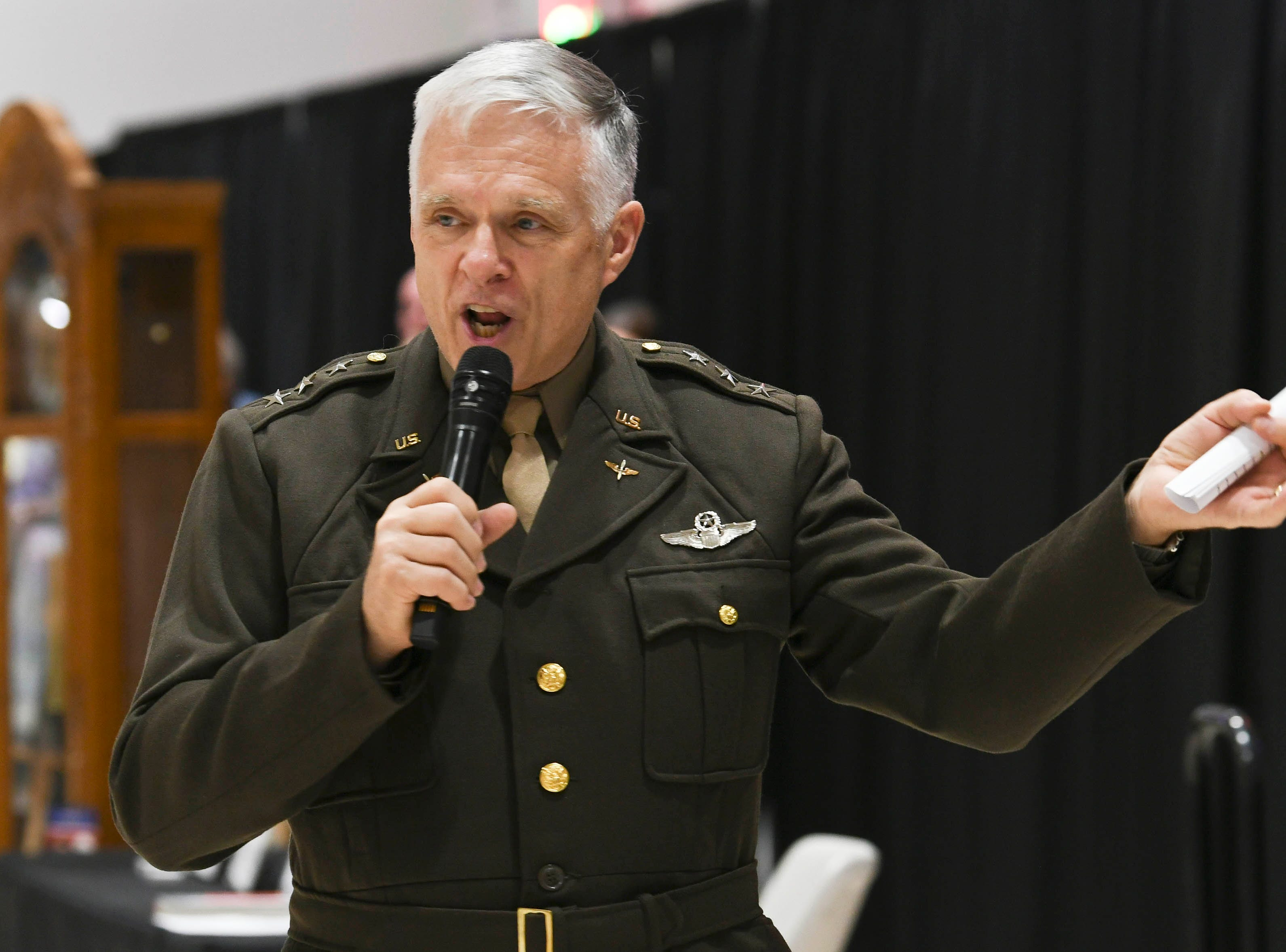 Bill Welser, president of Space Coast Honor Flight, addresses the crowd during Stars and Stripes at American Muscle Car Museum. The event was a fundraiser for Space Coast Honor Flight.