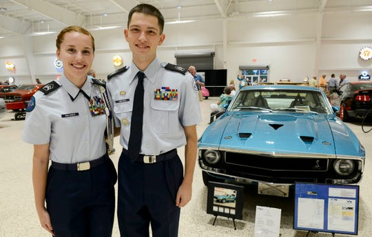 Carmen Ohlinger and Zackary Ampuero get their picture taken during the Stars and Stripes fundraiser at American Muscle Car Museum. The event was a fundraiser for Space Coast Honor Flight.