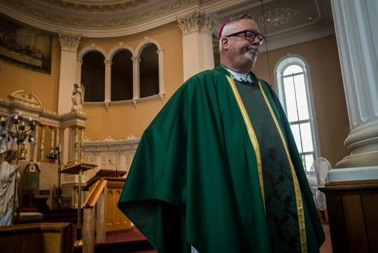 Burlington Roman Catholic Diocese Bishop Christopher Coyne answers questions after mass at St. Joseph's Cathedral on Sunday, Sept. 9, 2018, about a new investigation into alleged abuses at a former Catholic orphanage highlighted in recent a BuzzFeed News report.