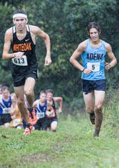 During the beginning of the 2018 cross country season, then Adena junior Emmitt Cunningham, right, fell on the hilly course at the Zane Trace Invitational due to the mud created by the nonstop rain during the race. Cunningham slipped and fell to pop his hip out of place, but would still finish the race.