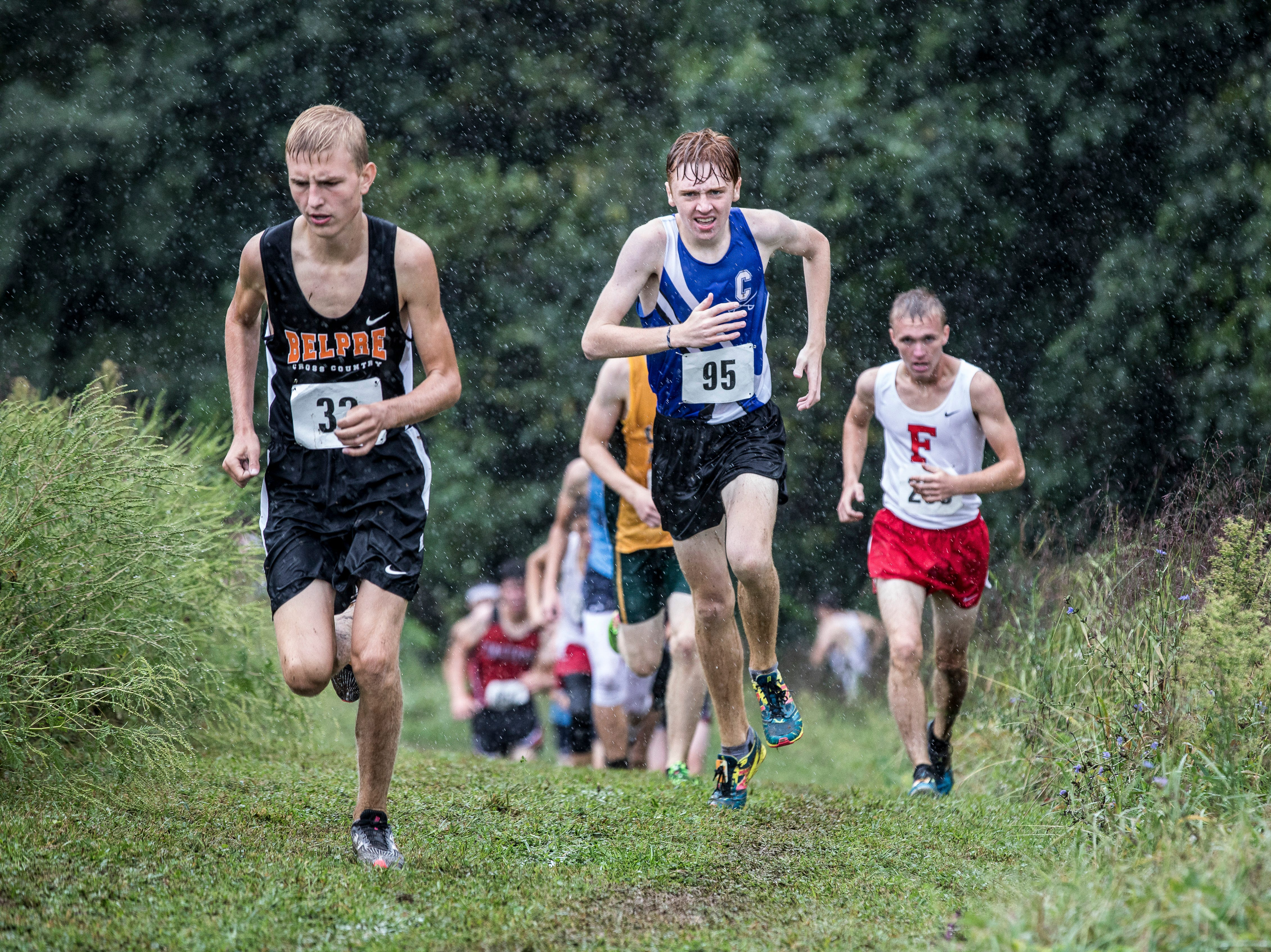 Chillicothe's Andrew McCallum, middle, took second place in the boys race during Zane Trace's annual cross-country invitational with a time of 18:02.63.