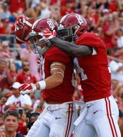 Alabama wide receiver Derek Kief (81) celebrates with wide receiver Tyrell Shavers (14) after scoring a touchdown against Arkansas State during the second half of an NCAA college football game, Saturday, Sept. 8, 2018, in Tuscaloosa, Ala. Alabama won 57-7.