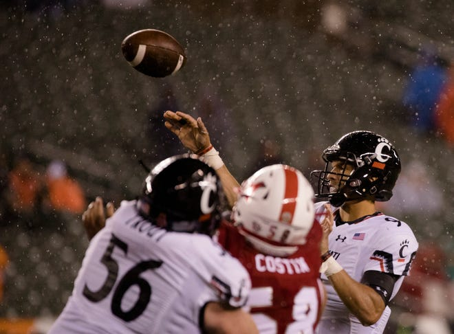 Left guard Kyle Trout (56) blocks a Miami University player while Cincinnati Bearcats quarterback Desmond Ridder throws a touchdown pass, in UC's 21-0 win on Sept. 8.