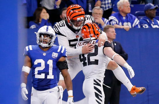 Cincinnati Bengals linebacker Nick Vigil (59) celebrates safety Clayton Fejedelem's (42) touchdown return in the fourth quarter of the NFL Week One game between the Indianapolis Colts and the Cincinnati Bengals at Lucas Oil Stadium in Indianapolis on Sunday, Sept. 9, 2018. The Bengals begin the season with a 34-23 win in Indianapolis.