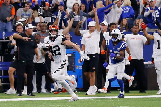 Cincinnati Bengals safety Clayton Fejedelem (42) runs back a fumbled ball for a touchdown in the final minutes of the fourth quarter of the NFL Week One game between the Indianapolis Colts and the Cincinnati Bengals at Lucas Oil Stadium in Indianapolis on Sunday, Sept. 9, 2018. The Bengals begin the season with a 34-23 win in Indianapolis.