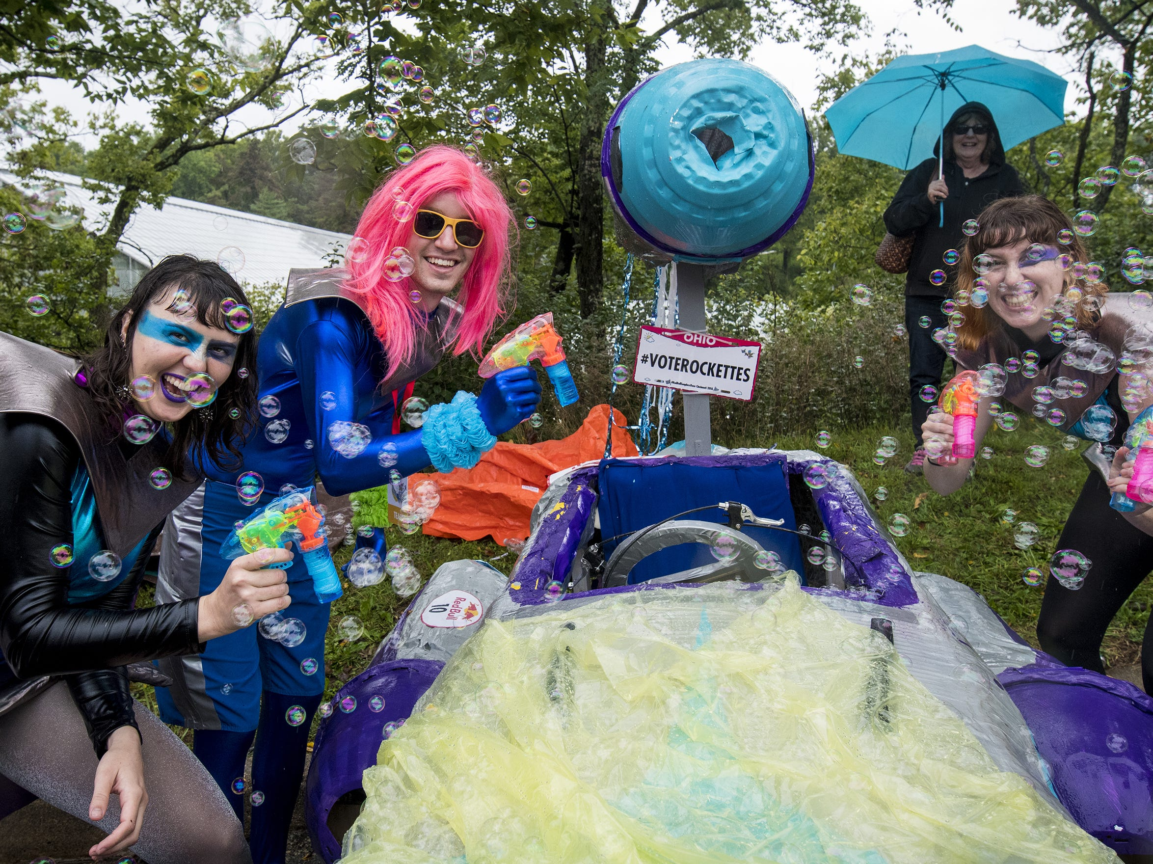 Dana Bennewitz, Collin Mulligan and Denise Funk of the Bangin Rockettes show off their soapbox car before the Red Bull Soapbox Derby Saturday, September 8, 2018 in Cincinnati, Ohio.